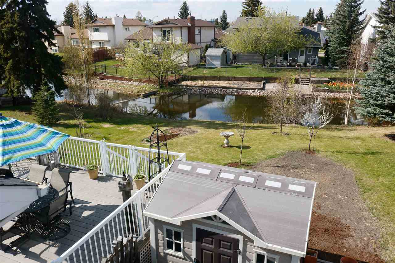BACKING WATER in Bearspaw! This immaculate 2 Storey Home is a must see. Pride of ownership is evident throughout this 5 bedroom House. Some of the upgrades to note are: NEWER Roof, Furnace, Windows, Bathrooms, SS appliances, patio door and more. The main floor boasts Vaulted ceilings and has a formal Living Room & Dining area. The Kitchen offers Solid Hickory Wood Cabinetry with a beautiful Butcher Block Island. There is a dining nook and another living area perfect for entertaining. Laundry area is also on this level with new LG Washer & Dryer with pedestals.  Upstairs you will find a Large Master Bedroom with separate walk in closet from the remodeled Ensuite. There are 2 more good sized bedrooms on this level with access to an updated 4 pc Bath. The FF Basement offers 2 more large bedrooms, New 4 pc Bathroom and entertainment room. So much more to list so come see for yourself.