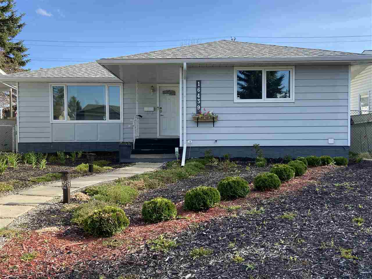 NEW $50,000 SOUTH FACING GREENHOUSE/ALL SEASONS ROOM ADDITION with FIREPLACE, WATER HOOK UP and DRAIN!!! Welcome to this cute bungalow in Elmwood, just a half block from schools. Lots of upgrades in the last couple of years. NEW WINDOWS (2017), NEW SHINGLES on the house (Dec 2017), NEW KITCHEN (2017), NEW FLOORING (2017), and built in cabinet in dining room. 3 bedrooms up, full bathroom and 2 pc ensuite. NEWER LIGHTING, NEW PANIT and NEW OUTSIDE and INSIDE DOORS. The basement is partially developed. There is a double detached garage, fully fenced and RV GATE for RV STORAGE. Located close to schools, West Edmonton Mall, Misericordia Hospital, public transportation, and major thoroughfares.
