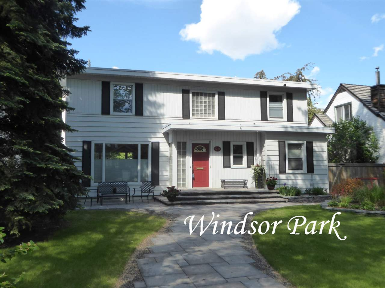 Walk-able Windsor Park! This attractive 2057 sq ft 2-story home has all the warmth & charm of a 50?s character home w/many updates including a tremendous addition that features a modern kitchen w/SS appliances, an abundance of cupboard & counter space, a bright breakfast nook, huge west windows & a large mudroom that has access to the sunny west yard filled w/colorful perennials. Additional main floor features include large formal living & dining rooms perfect for entertaining, a den/office, a 2-pce powder room & the roomy front foyer. The upper level has 3 good sized BDRMS & an updated 3-pce bath. Solid hardwood is found throughout most of the main & upper levels. The lower level has a family room, BDRM, 3-pce ensuite, a spacious laundry room & the utility room w/ amazing storage. Beautiful flagstone patios & walk-ways welcome the front yard & there is a 21.23 X 25.83 double detached garage. This home is perfect for a family or a professional couple working at the U of A or hospitals. A must to view!