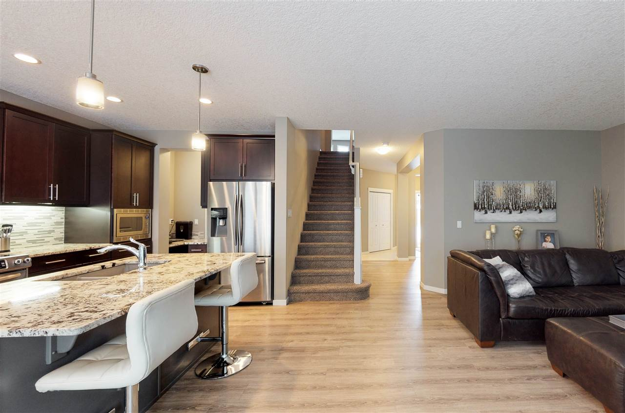 CUSTOM HOME, SOUTHWEST FACING (nearly 2500SF) built by Award winner Morrison Homes.  UPGRADED Tiles, Kitchen, SPA like Ensuite!  This open concept home comes with 9 Foot main ceilings, luxury wide plank flooring, tiles, Granite topped gourmet kitchen and a spacious great room to cozy up next to the gas fireplace.  FULLY AIR CONDITIONED! Main floor also comes with a large den, lots of storage and a walk-thru pantry.  Upstairs you'll find a large laundry with sink, 3 large bedrooms. A Spa-like Master bedroom spacious enough for a king bed, with 2 sinks, a tub and shower!  Down the hall you'll find a HUGE Bonus room, for Movie night, games or relaxing.  HOA TBC