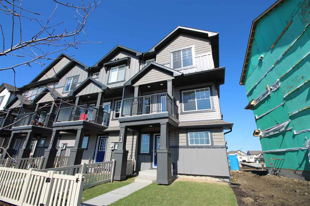 NO CONDO FEES and AMAZING VALUE! You read that right welcome to this brand new townhouse unit the ?Granville? Built by StreetSide Developments and is located in one of Edmonton's newest premier Southwest communities. With almost 1140 square Feet and a fully landscaped and a massive over sized double attached garage, this opportunity is perfect for a young family or young couple. Your main floor is complete with upgrade luxury Laminate flooring throughout the great room and the kitchen. Highlighted in your new kitchen are upgraded cabinets, upgraded counter tops and a tile back splash. Finishing off the main level is a 2 piece bathroom. The upper level has 3 bedrooms and 2 bathrooms.