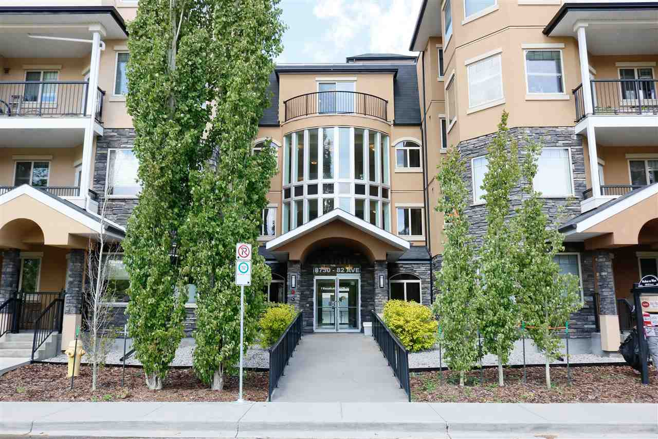 MADISON ON WHYTE!  Terrific secure building with reasonable condo fees (367.72). This SOUTH FACING 2 BEDROOM, 2 FULL BATH unit is bright and spacious, facing mature trees.  Features ISLAND kitchen with WHITE CABINETRY, OPPOSITE BEDROOMS, walk-in closet, HARDWOOD THRU OUT KITCHEN AND LIVING ROOM, 9? Ceilings, carpet in bedrooms, upgraded kitchen faucet, air conditioning and ONE UNDERGROUND PARKING STALL (#61) convenient to stairway. VISITOR PARKING. Sellers love the ravine walking trails, convenient access to downtown and festivals, Old Strathcona market, great restaurants and River Valley runs!  Transportation at your doorstep to U of A!  MOVE IN READY.