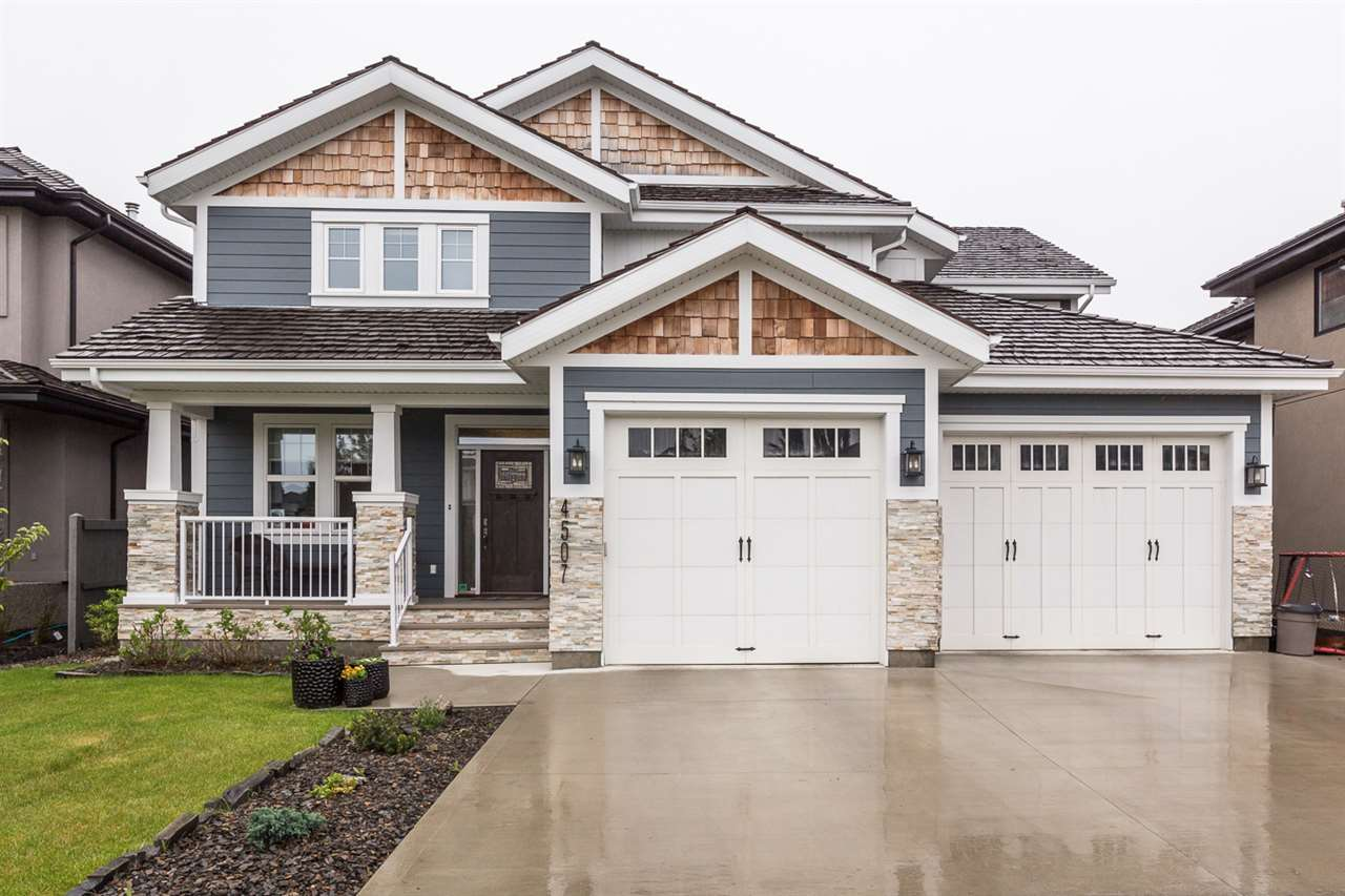 """Stunning 3+1,  3182 sq ft 2 storey in the Donsdale community is sure to impress! Upon entry you'll notice the details throughout house including lit coffered ceilings, built in cabinet and QUALITY of home. Cozy living room with brick facing gas fireplace and built in cabinetry surrounded opens up to the kitchen and dining room, with easy access to the partially covered two tiered deck. Kitchen offers a large counter island, gas stove, beverage fridge, three sinks + garburator and double stainless steel fridge/freezer combo. An office to complete the main floor. Upstairs features family room, 3 beds and 5 pce bath. HUGE master with gorgeous 5 piece ensuite including a """"his"""" and """"her"""" sink, separate toilet, jacuzzi tub, large stand up shower with a built in bench, plenty of cupboard space and stunning brick wall leading to the walk-though laundry room. In the basement you will find a large rec room with built in speakers, a good sized bedroom and 4 piece bath. Triple tandem garage, fenced and landscaped!"""