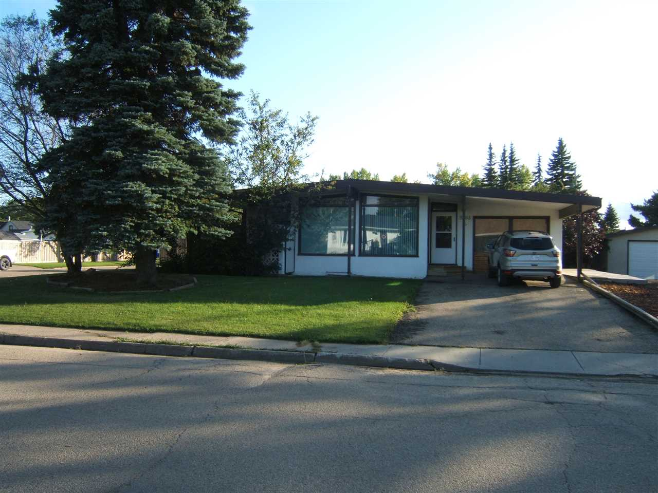 Great Value in this Well Maintained 1500+ sq ft,  3 + 1 Bedroom Home With 22' x 24' , 2 Car Garage On Large 75' x 140' Corner Lot In The Friendly Community Of Viking. Features and Recent Upgrades Include Laminate Flooring, Sitting Area With Gas Fireplace/Stove, Abundance of Maple Cupboards, Quality Appliances, Spacious Living Room With Large Windows for Plenty of Natural Light, Open Beam Ceiling, Mid Efficiency Furnace and a Metal Roof. Attached Garage Was Converted Into A Bonus Room Giving You Plenty Of Room For Family Activities and Gatherings. Next to the 2 Car Garage Is Space For R.V. Parking. Great Property for a Growing Family or Retirement Couple. This May Be The Property You Are Looking For!