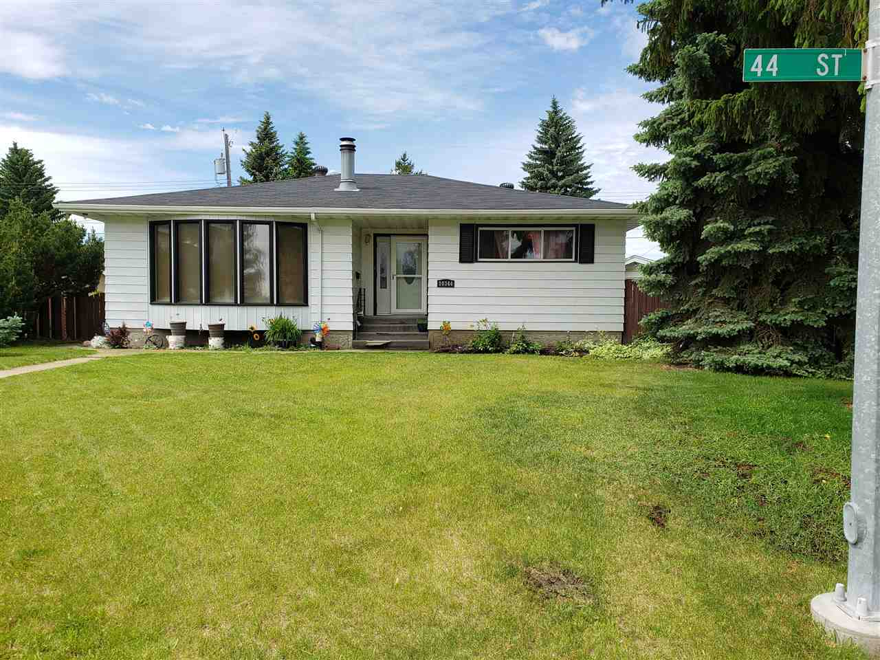 This 2 bedroom 1539 sq feet  open concept bungalow located on a quiet street in gold bar has a newer high efficiency furnace and 60 gallon hot water tank. Kitchen  has stainless steel appliances double gas oven and 5 burner stove highlighted by quartz counter tops, solar tube for added brightness, drinking water tap with 7 filters, air conditioning and hardwood floors through out home. Master bedroom has walk in closet with own ensuite. Home includes a summer kitchen in the basement and 2 additional bedrooms and full bathroom to accommodate the growing family. Back yard is huge on a pie lot, fully landscaped and has a large oversized double garage and RV parking. With a little TLC this house could be your home.  Priced at $ 421,000.00