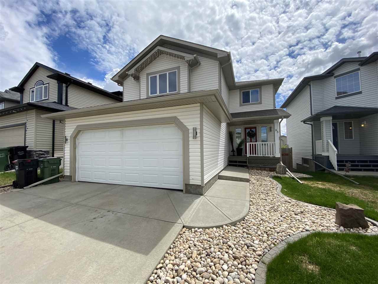 WALKOUT BASEMENT! BEAUTIFULLY RENOVATED KITCHEN! LARGE DECK! SOUTH FACING YARD! 24' DEEP GARAGE! GREAT FAMILY HOME! This 1833 sq ft (2524 TOTAL) 4 bed, 3.5 bath home BACKS A POND and has been nicely maintained! The main floor brings an open concept living / dining / kitchen, w/ a ton of windows, ample natural light, newer laminate flooring, S/S appliances, granite countertops, updated backsplash, fresh paint, corner pantry & gas fireplace! Upstairs you find a large BONUS ROOM, 3 good sized bedrooms, including the master bed w/ 4 pce en-suite & w-in closet. The basement is fully finished, with a large 4th bedroom, rec room for movie night, and 4 pce bath, & WALKOUT access to your huge yard! Good storage space, and nice flooring & drop ceiling. The yard is spectacular! Large deck for entertaining, w/ great space for the kids to play, summer bonfires, and great views with no direct neighbours behind! Located on a quiet crescent, call this gem home today!