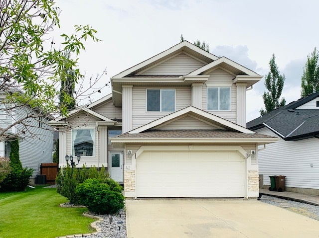 WELCOME to the Beautiful and Family-Friendly Neighbourhood of Deer Ridge!  This meticulously maintained bi-level has a well-designed open-concept, perfect for entertaining!  You?ll love the bright windows, gleaming hardwood, soaring vaulted ceilings, new SS appliances, and cozy gas fireplace.  Grab a glass of wine and relax on your large south-facing deck overlooking your private and lovely treed/landscaped yard.  The Master Suite features an amazing Ensuite w/ jetted soaker tub for two!  Main floor is complete with a Flex Room at the front, 2 more generous Bdrms and Full Bathroom.  Huge Rec space in the beautifully finished Lower Level, with large windows, a 4th Bdrm, and partially started Bathroom. New 2 stage variable High Efficient Furnace, new 60 gal HWT, Central A/C, spacious Deck w/ storage underneath, Stone Patio, finished/insulated Garage, Firepit.  A PERFECT HOME for families, first-time buyers or empty-nesters.  This move-in ready home is a MUST SEE!