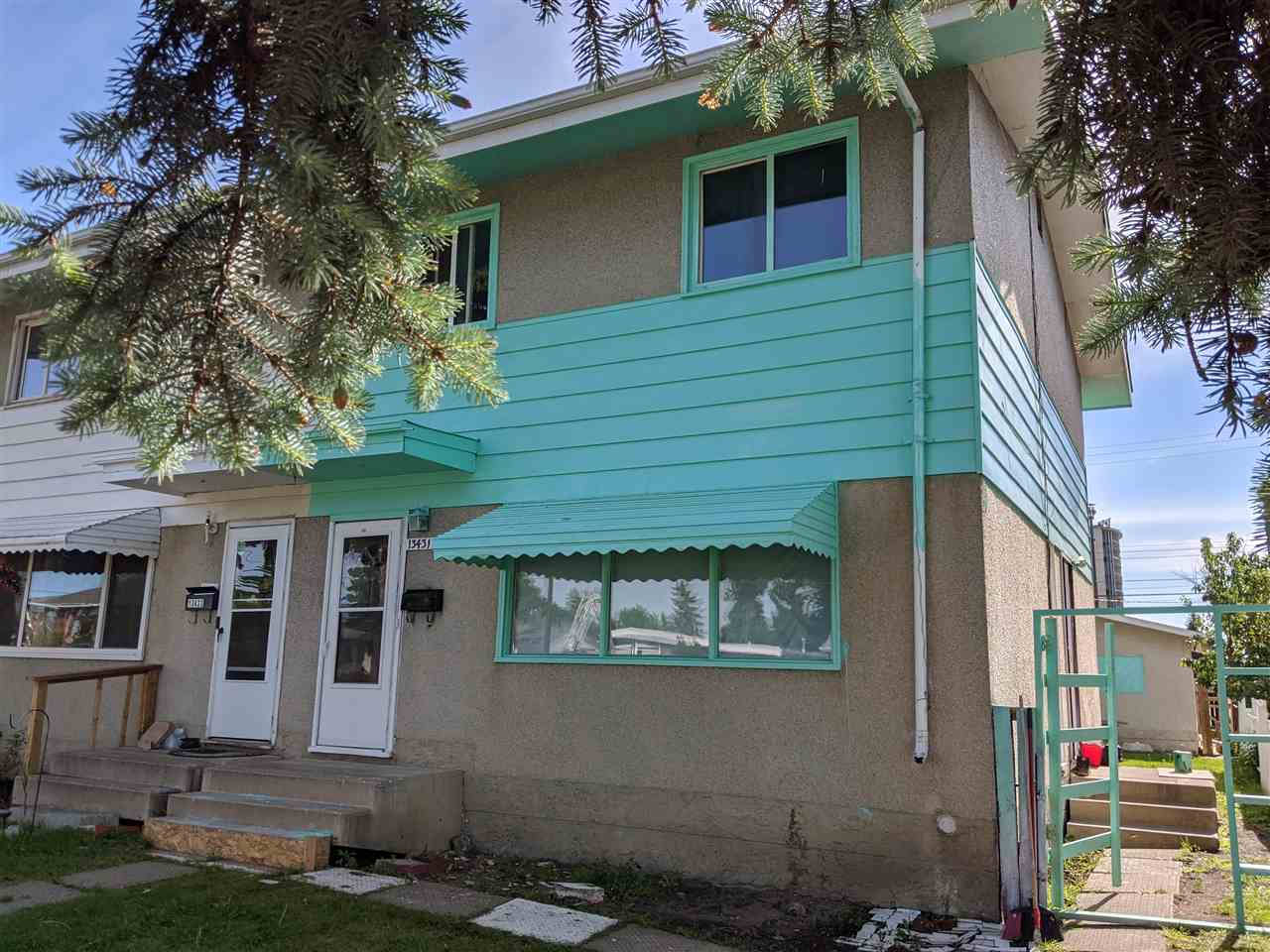 Priced well below Assessed Value of $244,000 !  A must have rental or renovation project with not much more to do than some cosmetic repairs.  Truly a great opportunity for someone looking to add a property to their portfolio. It features a newer furnace and hot water tank.  A double car garage with a nice parking pad behind it with ample room for parking.  NO CONDO FEES.  Great location off the beaten track.  Priced to sell quickly!