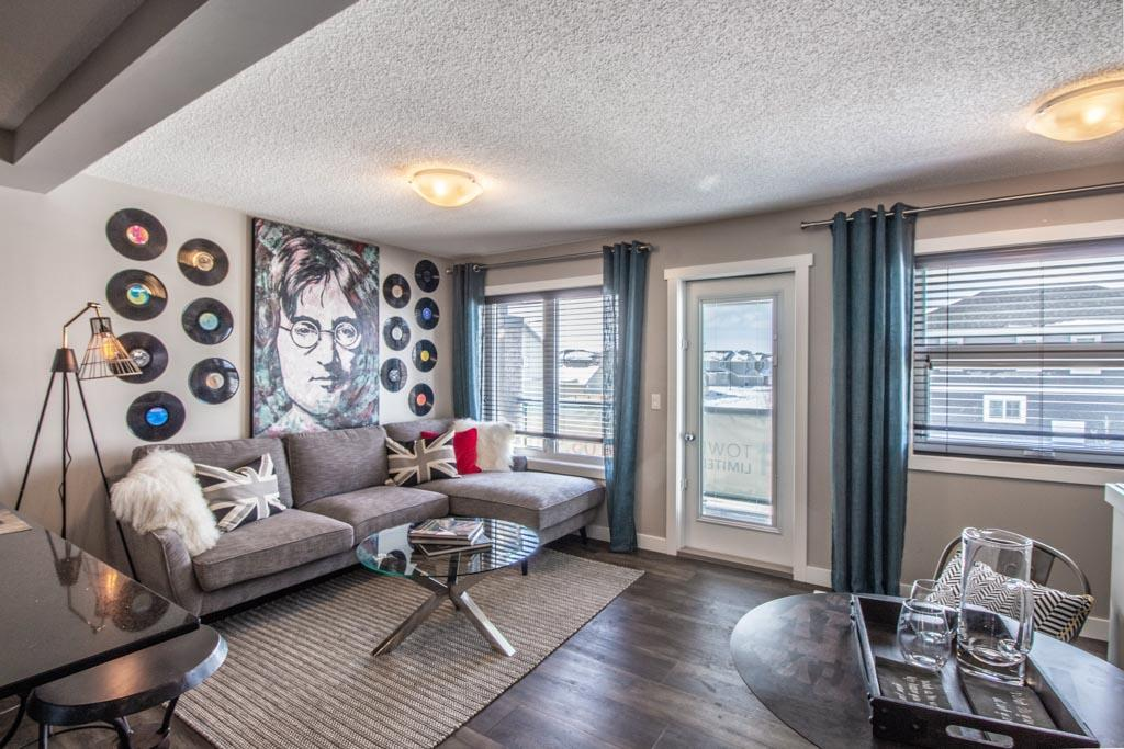 """This is StreetSide Developments the """"York"""" model. This innovative home design with the ground level featuring a single attached garage that leads to the front entrance/foyer. This suite is on the second level. It features a large kitchen. The cabinets are full size and there is a full back splash & quartz counter tops. It is open to the living room. The living room features lots of windows that makes is super bright. . The deck has a vinyl surface & glass with aluminum railing that is off the master bedroom. This home features 1 master bedroom with a walk in closet and a 4 pce. bath with an enclosed laundry room with stackable washer/dryer. The flooring is luxury vinyl plank  & carpet.  Maintenance fees are $108/month. It is professionally landscaped. Visitor parking on site.***Pictures are from Show home and is the same layout colors and finishing's may differ ***"""
