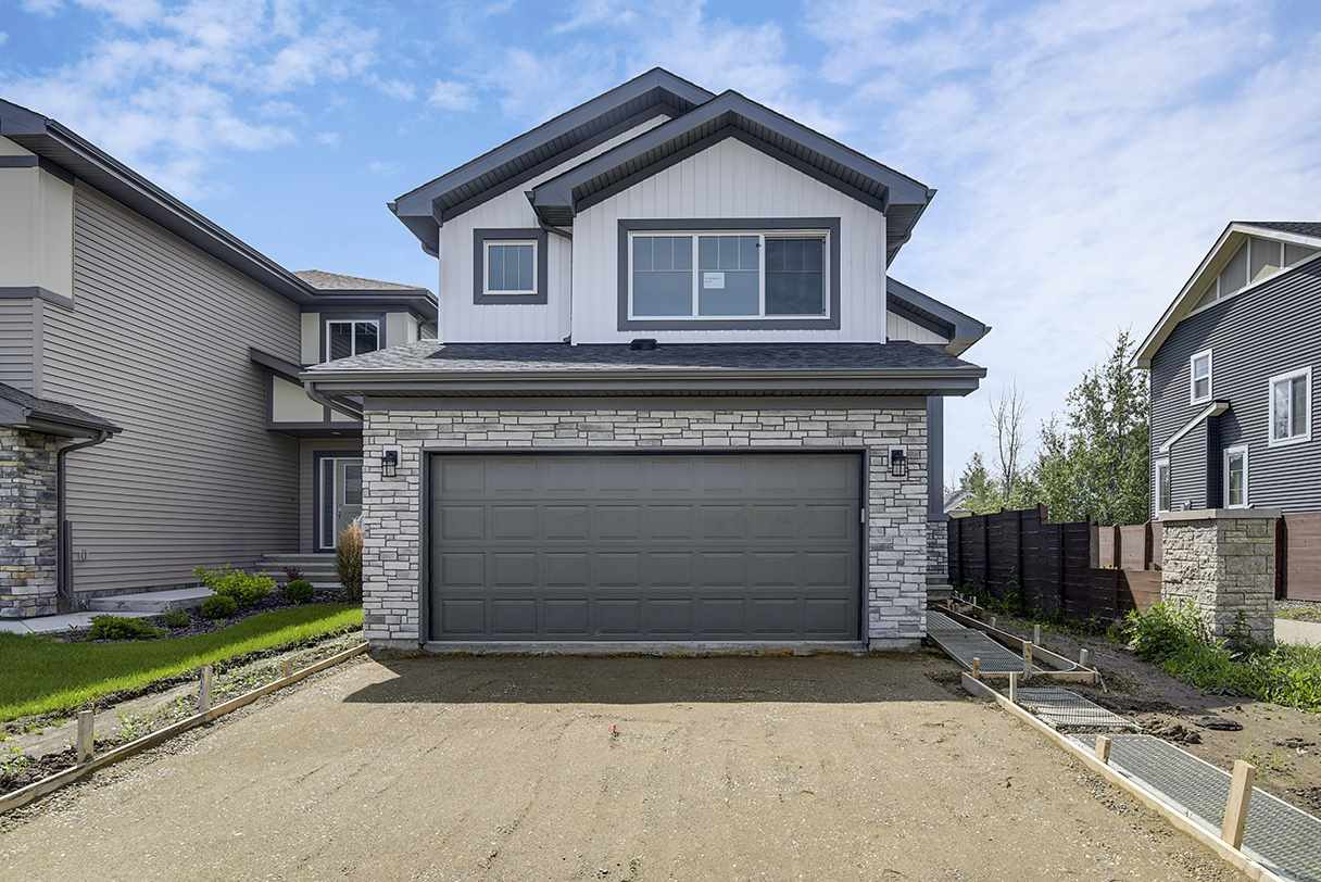 This charming 1.5 Storey home offers 1354 square foot with 2 Bedrooms, 2 full Bathroom, Chef's Kitchen with walk in Pantry, Gas Fireplace and double attached Garage
