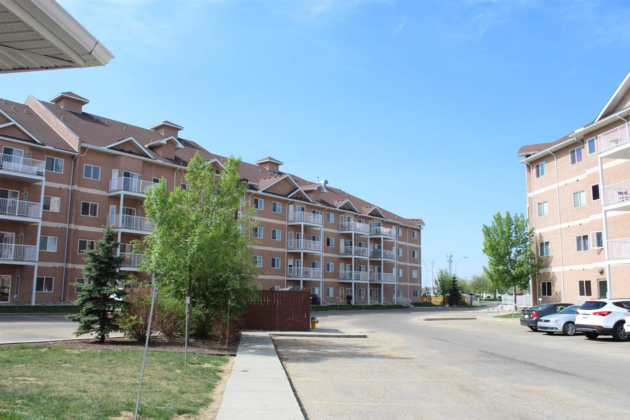 Beautiful well maintained apartment style condo located in the well sought after community of Claireview Town Centre within walking distance to Clareview Station, as well the Clareview Sports Centre. Features a nice sized coved kitchen with loads of cupboard space and upgraded appliances , a dining area, a large living room with a patio door leading to a balcony with gas hook up for your BBQ, a huge master bedroom, a 4 piece bath, own in-suite Laundry, and additional bedroom/office. Comes with an underground titled stall, storage cage and a titled, above ground stall. Amenities include, a car wash, exercise room, games room and a Social Building. What a great place to call home and is a real pleasure to show.