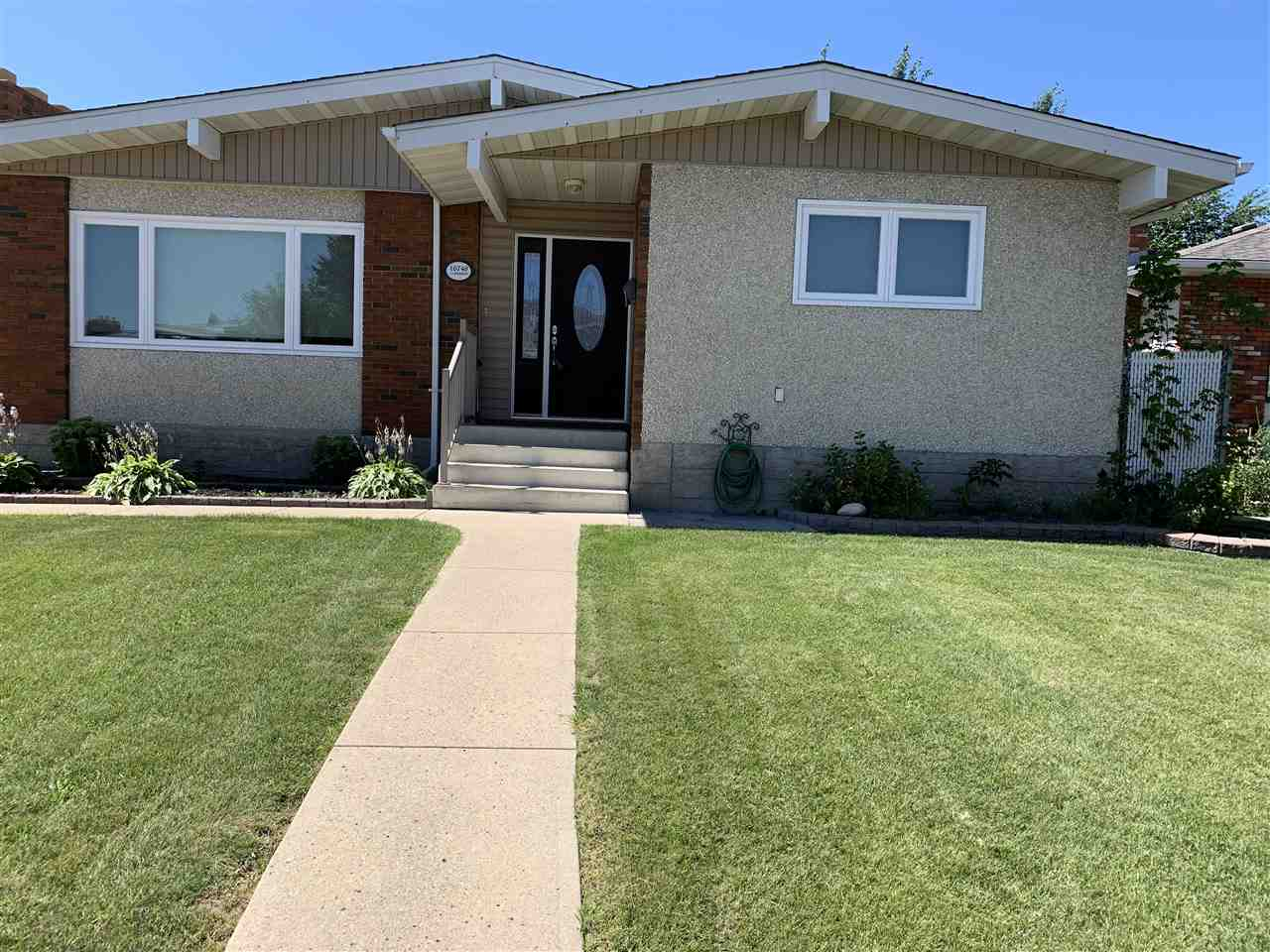 What a beautiful bungalow in Baturyn! Pride of ownership, original owners. With almost 1300 SF of living area on the main floor and a developed basement, there is no reason to look any further. There have been many updates to the home including vinyl windows and doors (2016), new asphalt shingles (2016), and new custom blinds (2018). As you enter the home you will notice the newer hardwood flooring and ceramic tile. No carpet on the main floor. There are 3 spacious bedrooms and the master boasts a 2 piece ensuite. The kitchen has plenty of counter space and a gas stove. Great for the hidden chef in all of us. As an added bonus the laundry room is upstairs. The basement is fully developed and contains a large bedroom, 2 piece bathroom (the ability to add a shower is there), another laundry room, family room and a small area that can be used as a kitchen. The backyard is huge and features an oversized detached garage (24x26) and a huge garden. Come see what the fuss is all about. Baturyn at it's best.