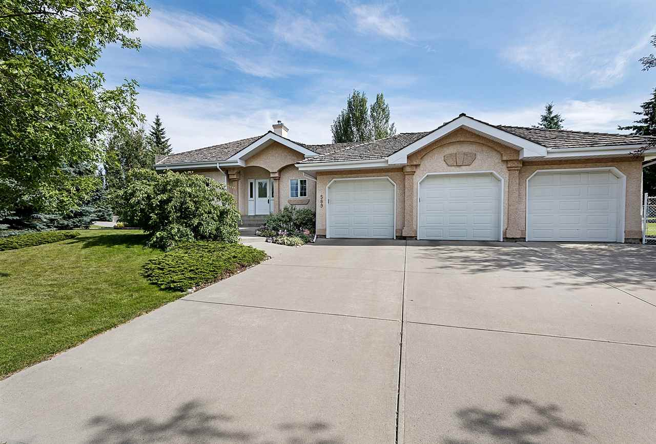 How?s this for value, 1818 ft.² 3+1 bedroom bungalow located in the Estates of Sherwood Park. This home features 9 foot ceilings, a 5 piece ensuite bathroom with a large jetted tub and a walk-in closet. Good sized open concept kitchen with Island & Garden doors to a west facing private patio. Gorgeous gas fireplace with wood mantle and stone finishing in a large Great room. This very sunny home has lots of L windows Thru out.. let?s not forget the fully finished basement that includes a large bedroom with a 4 piece en-suite bath, a good size rec room, office, craft room and lots of storage. Also features a triple attached garage & a 1/3 acre west facing yard.