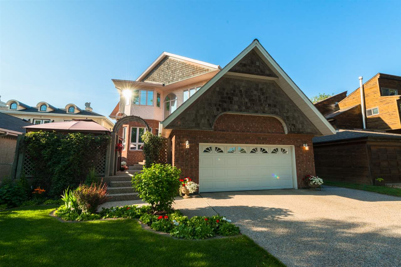 Oak Lovers Wanted!! Welcome to your private getaway, minutes from Downtown Edmonton. With over 6500 sqft of living space, this massive Custom Built home boasts 5 large bdrms & 4 bthrms, including a 6 piece master ensuite. The main floor hosts an ornate formal dining room, living room with 12' ceilings & a conservatory. The 7' granite island w/ a breakfast bar, high end appliances, custom cabinetry & large dinette, accompany the chef's kitchen. The lower level includes 2 of the 5 bdrms, Family Room, and Games Room. You will be exceptionally close to downtown Edmonton's fine dining, shopping, Ice District, Muttart Conservatory, Edmonton Ski Club, Royal Alberta Museum, the Art Gallery of Alberta & the Winspear Centre for Music. You are also minutes from Edmonton?s French Quarter, U of A, the U of A Hospital & the Royal Alex. Enjoy spectacular downtown skyline views while still having a private yard. This homes elegant charm is perfect for gala entertaining, yet very much a family home.