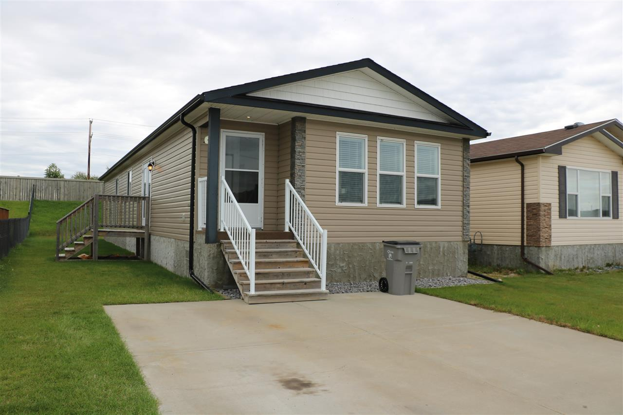 Super clean 3 bedroom home in Stony Plain on a permanent foundation and You Own the Land!.  Close to Shopping, Restaurants, and the Hospital. Enjoy plenty of room in this wide open plan that features wood cabinets in the kitchen along with huge walk-in pantry. There is a side deck to BBQ from just off the dinette. The Master Bedroom is also spacious with large walk-in closet and 4 Piece ensuite with corner jetted tub...nice! The 2 other bedrooms offer plenty of room as well and are served by a 4 piece bathroom. The laundry room is massive and features a Solar Tube that floods the space with natural light. There is a 2 stall concrete parking pad conveniently right out front.