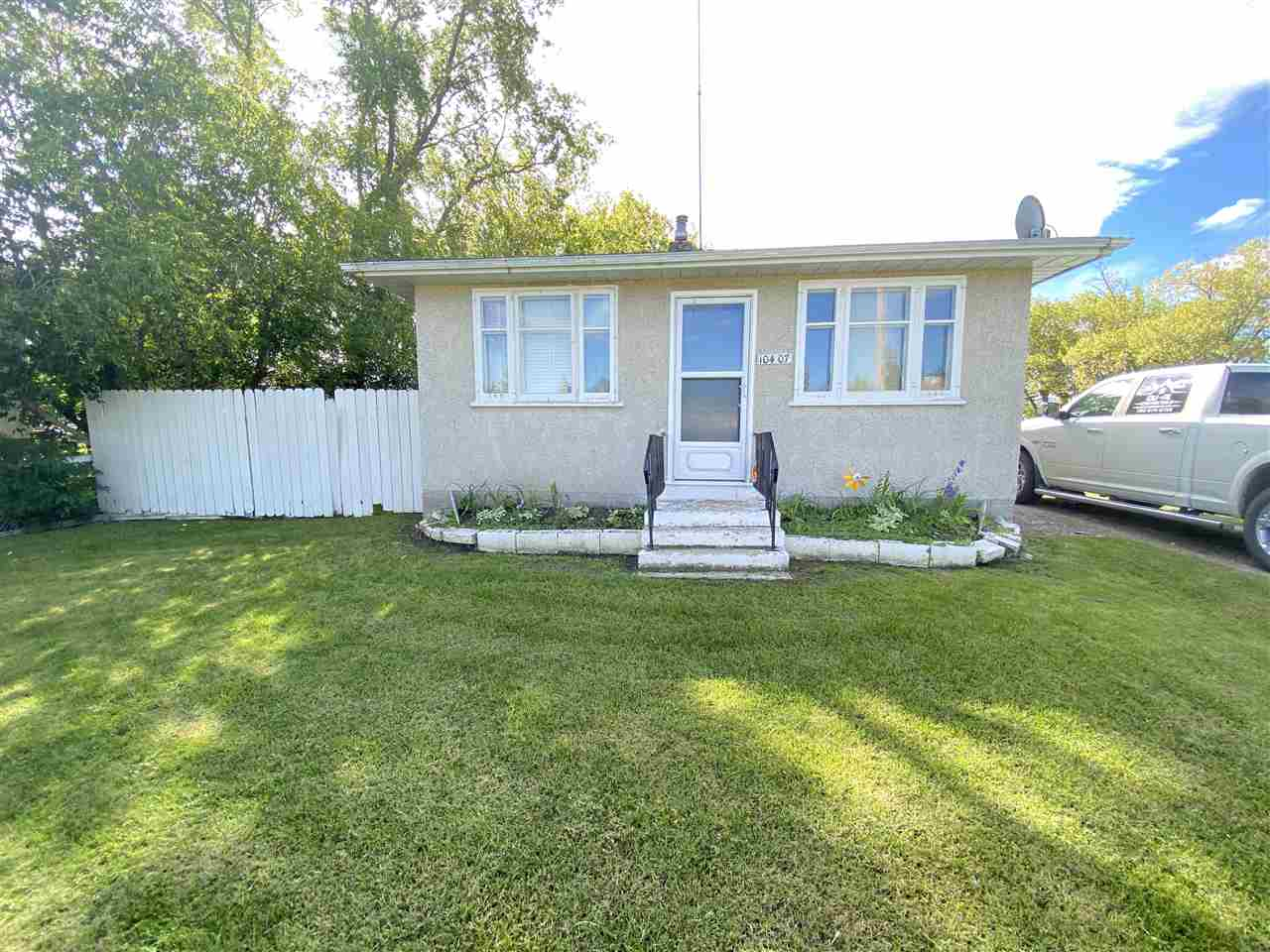 "HOUSE SOLD ""AS IS"".   Seller willing to consider RENT TO OWN!! 2 bedroom bungalow on large lot!!  Quiet setting located at the end of 103st.  Double Detached built in approx 1986.  Lot to the west is also listed!  Investment oppurtunity to buy 2 lots for a great price!"