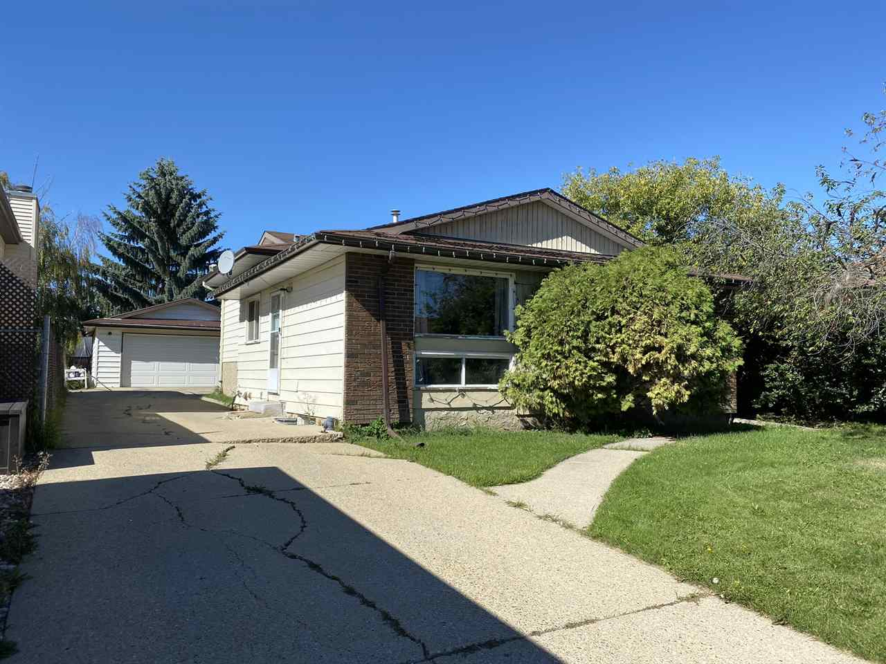 Awesome 4 split with parquet hardwood in the living room and dining room and ceramic flooring in kitchen and bathrooms. Features a large yard with double garage. Close to shopping, schools and public transportation. Rental income $1600 tenant pays utilities. Great potential!