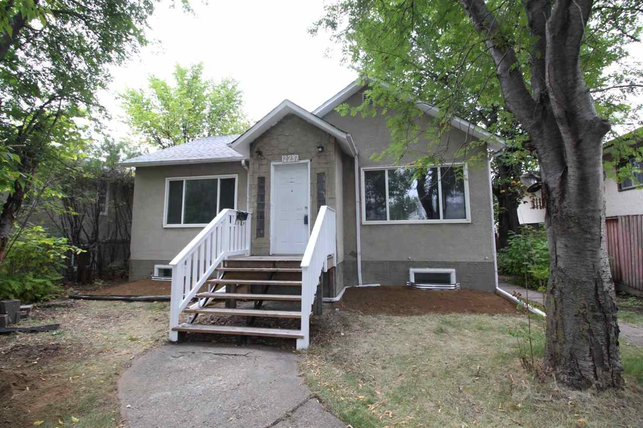 Motivated Seller! Significantly below assessed value! Great investment opportunity or a first time home buyer! 3 bedroom bungalow on a large 50' x 150' (RF3), your quiet, tree-lined oasis in the middle of Edmonton, minutes from downtown and walking distance to NAIT. The main floor has a large living room, dining and kitchen. Completing the main floor is 2 bedrooms and a 4 piece bathroom. The finished basement comes with a family room, 1 additional bedroom a 2nd kitchen area and brand new carpets. The 3 piece bathroom will need some work. This home has potential and is situated in a great location, 20 minutes to any corner of Edmonton with easy access to 97 street, Downtown, Kingsway Garden Mall and public transit system. Don't miss out!