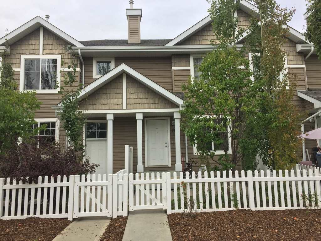 Affordable Townhouse at best location across Terwillegar Recreation Centre. Your mortgage can be less than your rent. Beautifully landscaped Complex in a quiet neighborhood street. Well maintained 2 story unit with 3 bedrooms & 2 baths with open concept living space. West facing front opens up to landscaped yard & makes interiors sunny and bright. As you walk in the open foyer, you have a view of an extra-large Living Room area with dark maple floors & and L-shaped kitchen with natural maple cabinets. This Kitchen has loads of cabinets, generous sized pantry and Centre Island for Chef?s convenience. Enjoy family dinners at your spacious dining area besides the kitchen. The upper floor has 3 spacious bedrooms, master bed with large walk-in closet.Besides MB is an open flex area for your personal touch. This townhouse comes with insulated and dry walled double garage with direct access at ground level. There is enough parking for visitors. It takes 5 minutes of a walk to Terwillegar Rec.10 Minutes to Ufa