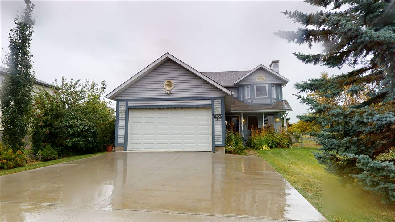 Welcome to this 3+2 bed, 3.5 bath 2 storey home located in the quiet community of Waskatenau.  As you enter, a gracious foyer leads to the main level. Efficiently designed kitchen boasts oak cabinets, S/S appliances, center island eat-up bar, breakfast nook w/garden door access to a west facing deck & back yard. Entertain guests in the formal dining room or relax with family & friends in the sunken living room. Half bath & large mudroom are conveniently located by entrance to garage. Upstairs, sun drenched master bedroom boasts newer windows (2018) & updated 4 pc spa-inspired bath. Two additional generous sized beds & lg. 4 pc bath are perfect for the growing family. Highlights of lower level include lg family room, 2 beds (one w/3 pc en suite bath), laundry/utility room. Dbl garage has new heater (2019), 220 wiring, shelving & 2 man doors. Fenced & beautifully landscaped yard w/stately trees on 2 lots w/shed & playhouse. Other features: concrete pad (2016), refrigerator (2019), thermostat (2019).