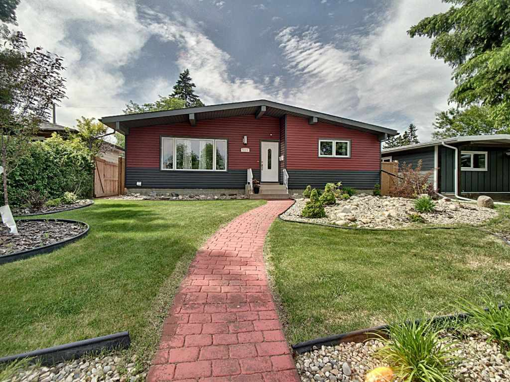 Stunningly renovated bungalow in sought after Lendrum! Walking distance to LRT w/ quick access to Southgate Mall, UofA & Downtown. Lrg East facing open concept Great Room is inviting & conducive for entertaining. Featuring high vaulted ceilings, exposed beams, gas F/P, H/W floors, lots of natural lighting & views of the park across from the home. The chef's kitchen has custom-designed cabinets, quartz counters & S/S appliances. Spacious master offers 3pc ensuite & private access to deck. 2 more bdrms, laundry, A/C & 4pc bath complete main floor. 2 Bdrm Legal Basement Suite includes 4pc bath, in-suite laundry, & open concept living/kitchen. Legal basement suite was previously rented for 2 years at $1450/mth. Professionally landscaped yard w/ green space, mature trees, stamped concrete patio, fire pit area, deck & heated 2 car garage w/ additional parking pad complete this picturesque home
