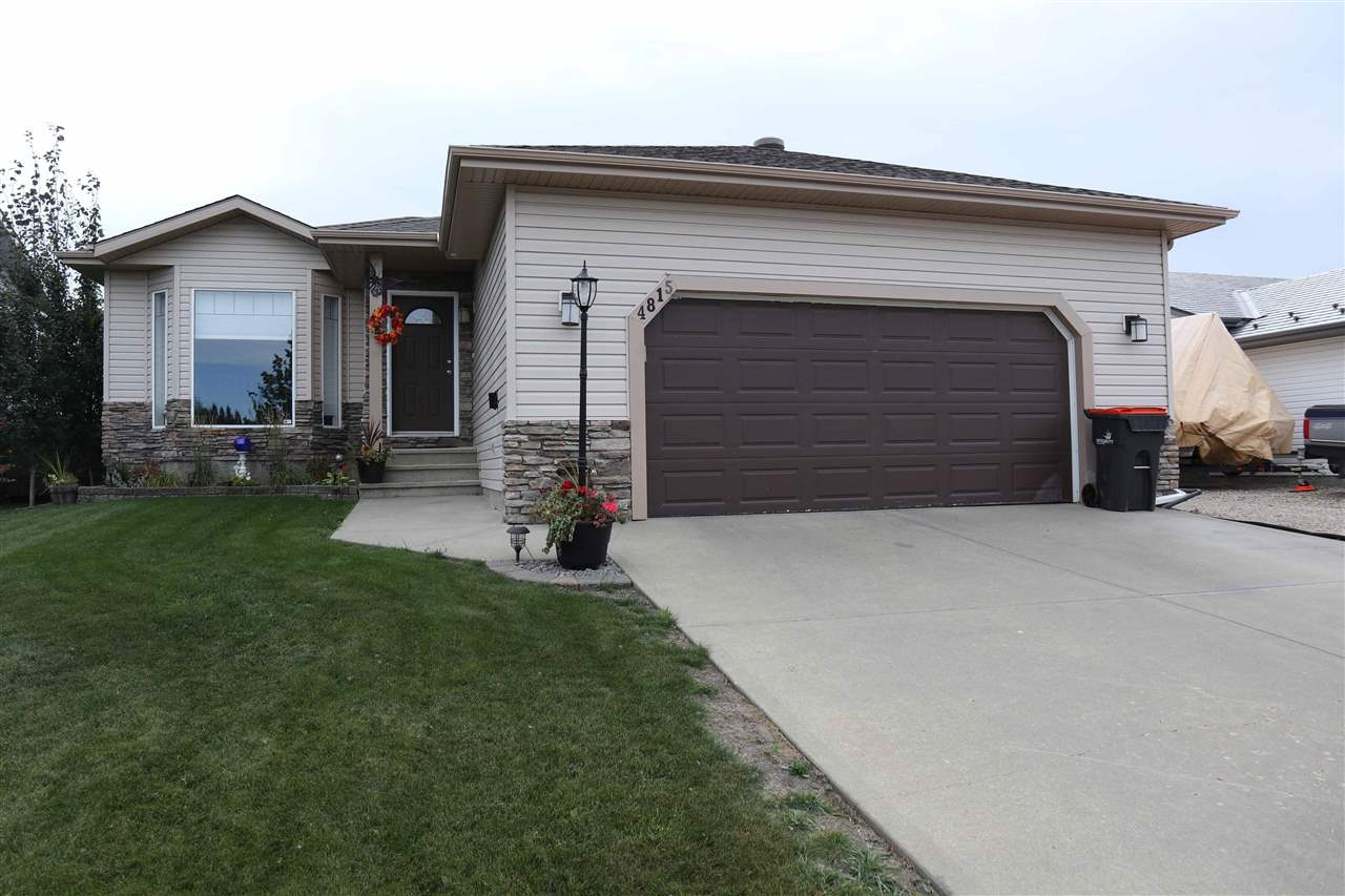 Beautifully maintained 1300 sq. ft. bungalow is located on a quiet street in Thorsby.  Front entry has access to att garage.  Gleaming H/W in the living room & hallway.  Bright LR features vaulted ceiling, bay window, gas F/P with tile surround.  The kitchen has plenty of gorgeous cabinets, pantry, pot lights.  All appliances are less than 4 years old.  Adjacent dinette has a garden door leading to the back deck with gas outlet.  Main floor laundry is located in the hall.  Master bedroom features 2 closets, 3 pce ensuite with pedestal sink & shower.  The 2 secondary bedrooms are good sized.  Art niche in hallway.  4 pce bathroom completes the main level.  The basement is finished & includes a huge rec room, bar area with sink, cabinets, ceramic flooring.  3 pce bathroom has W/I shower.  4th bedroom has a walk through closet.  Battery backup on sump pump.  Dble att garage is heated, insulated & drywalled. RV parking.  Beautifully landscaped with loads of trees. Fenced backyard. Shed. Shingles replaced 2019
