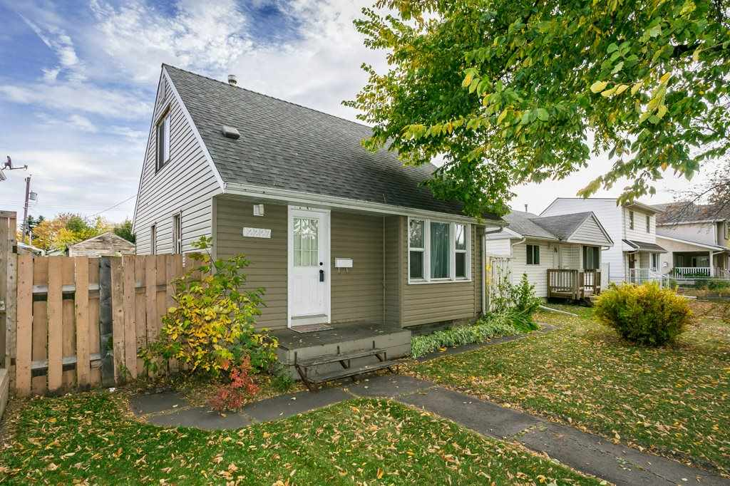 INVESTORS & FIRST TIME BUYERS!!  This cozy & updated home is just minutes from NAIT, Downtown & Yellowhead Trail.  Situated on a quiet tree-lined street this 1.5 story cutie boasts 945 Sq. Ft., 2+1 bedrooms, 1 bath, finished basement and a large lot with future infill possibilities.  Single detached garage is older but still fully capable of sheltering your vehicle with additional parking at the rear or in front.  Numerous UPGRADES include:  NEWER SHINGLES (2012), WINDOWS/DOORS, BACK FLOW VALVE & MAIN STACK, H20 TANK (2019), SIDING/SOFFITS/FASCIA, ELECTRICAL, SOME AREAS FRESHLY PAINTED.  Large living room open to a spacious dining area flanked by windows for tons of sunlight.  Upstairs features 2 generous bedrooms.  Main floor full bath has been updated with newer fixtures and subway tile.  Basement is finished with a large laundry/storage room, small family/rec room and a 3rd bedroom/den option (Note: window is not egress compliant).  Off the back entry features a good sized deck and a huge yard space.