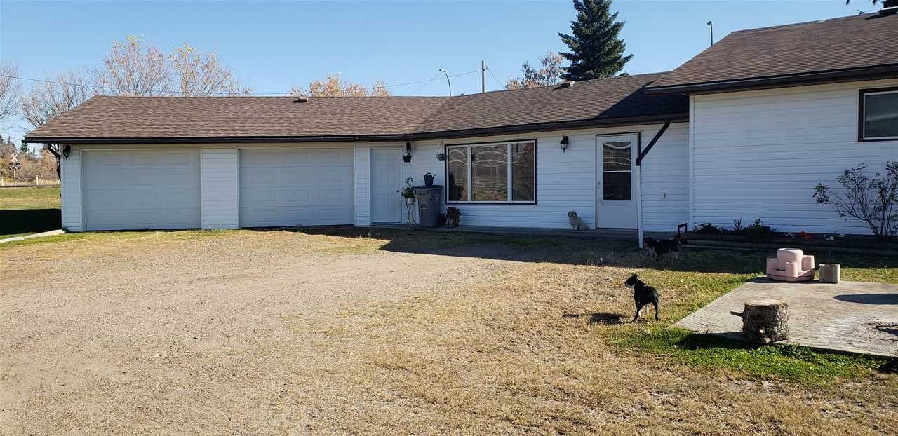 Unique acreage in the town of Mundare on 2.3 acres at intersection of HWY 15 and HWY 855.  This large 2 bedroom 1 bathroom basementless bungalow has an oversized double attached garage and is walking distance to a golf course.  Only 30 minutes from Sherwood Park, this very affordable property can be converted to a business.  The master bedroom has sliding glass doors to the garden area and this home boasts very spacious rooms.  Shingles are new from 2020 with some newer windows and paint. This acreage has a field septic system and well water with a water softener.
