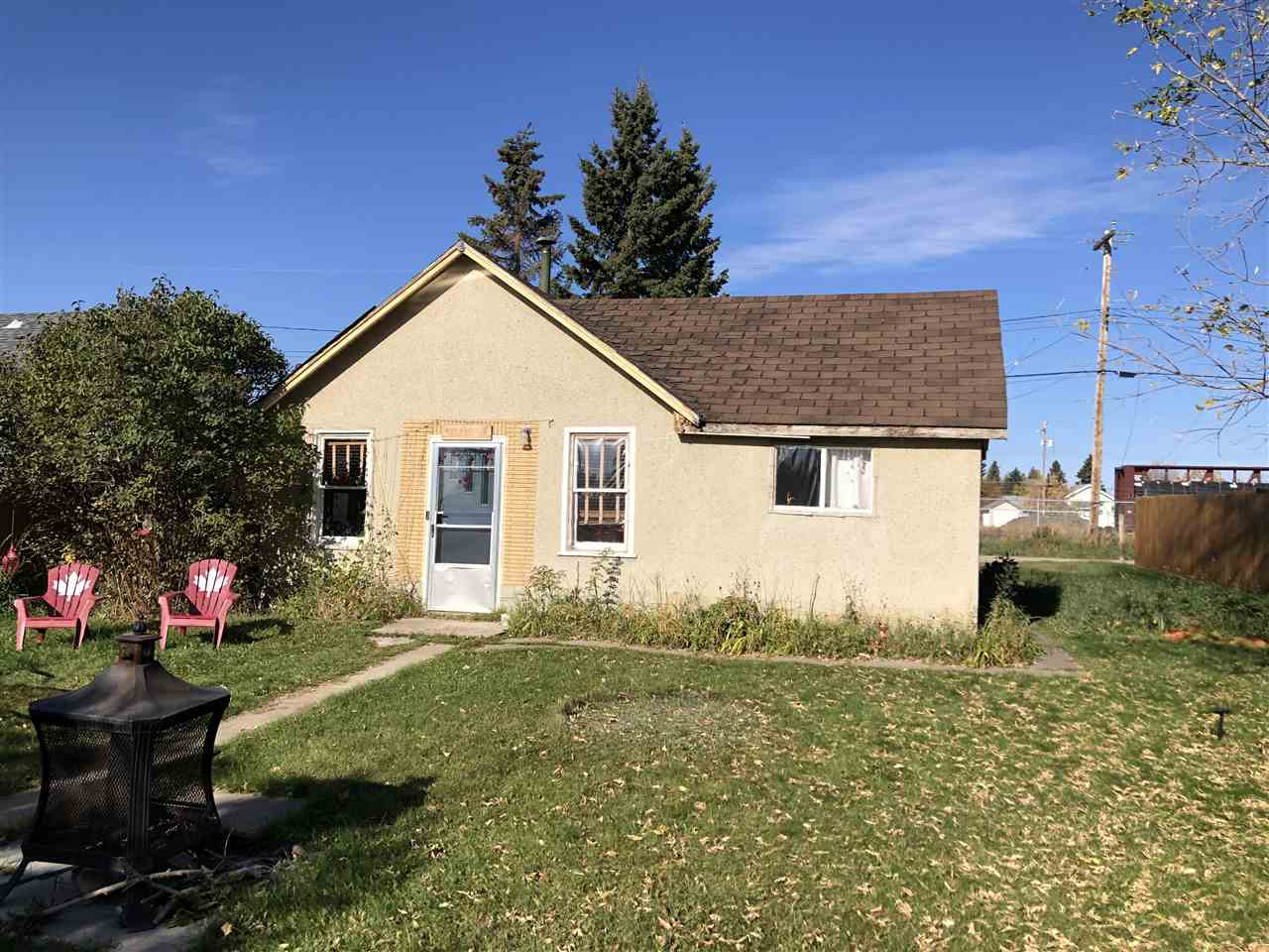 Great little starter home or rental investment opportunity. Quiet area downtown walking distance to all amenities.  672 sqft including the addition. 2 bedroom, 1 bath. Newer paint. Good sized porch. Great yard, partially fenced, space to add a garage. Handyman special.