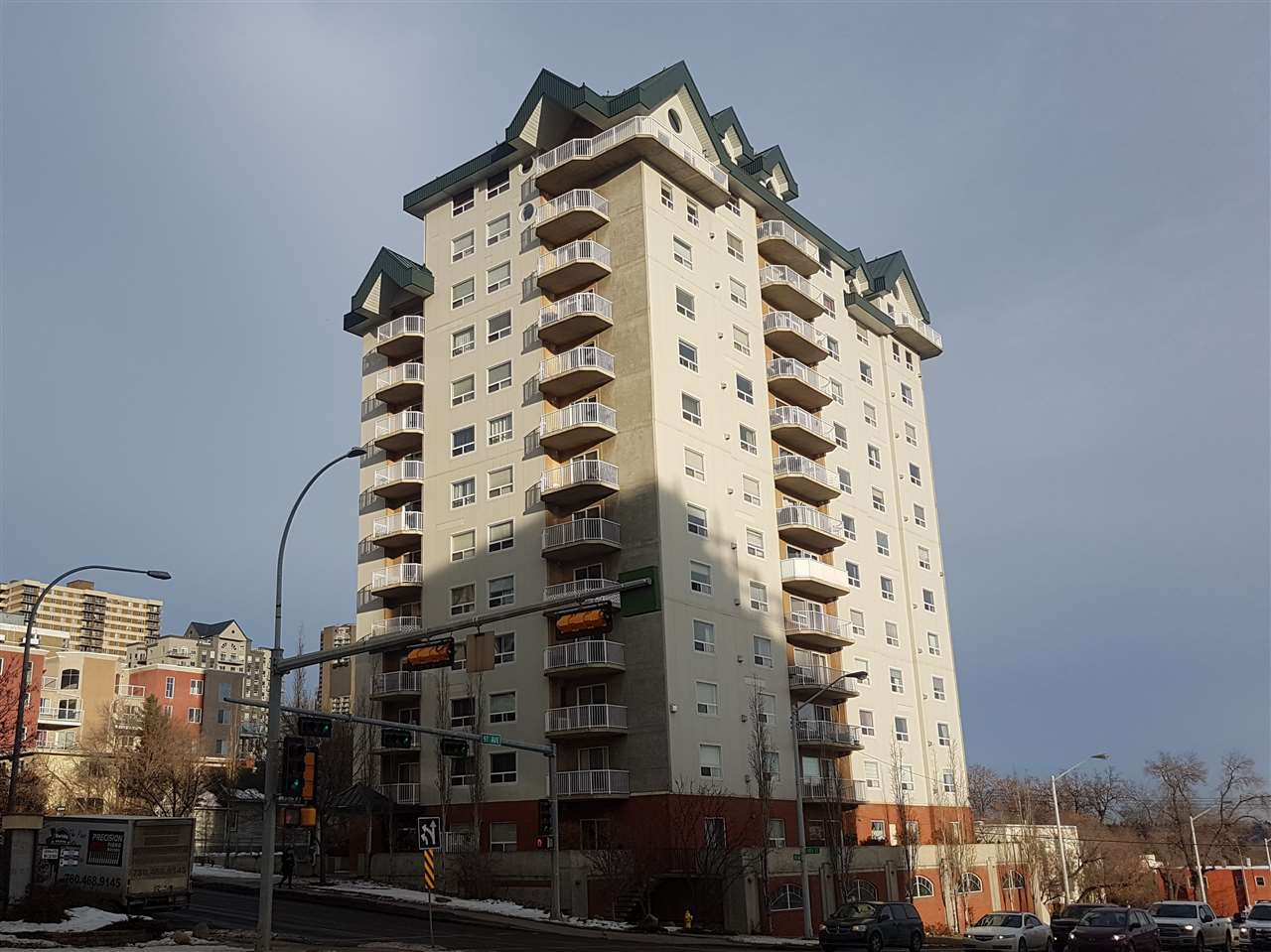Excellent value for a corner unit in a newer concrete building with south river valley views!  Very spacious 1228 square feet seems even larger with the 9 foot ceilings.  2 bedrooms and both have walk in closets.  2 bathrooms as well, plus there is a large in suite laundry room.  The kitchen features an eating bar, ample counters and numerous cupboards.  Other features include: gas fireplace, underground titled parking stall, southeast corner balcony with gas line for bbq, large sunny windows facing south that overlook the new low level bridge, ball park and river.  The complex also has a fitness room and there are numerous visitor parking stalls for guests. 18 plus age restricted building.