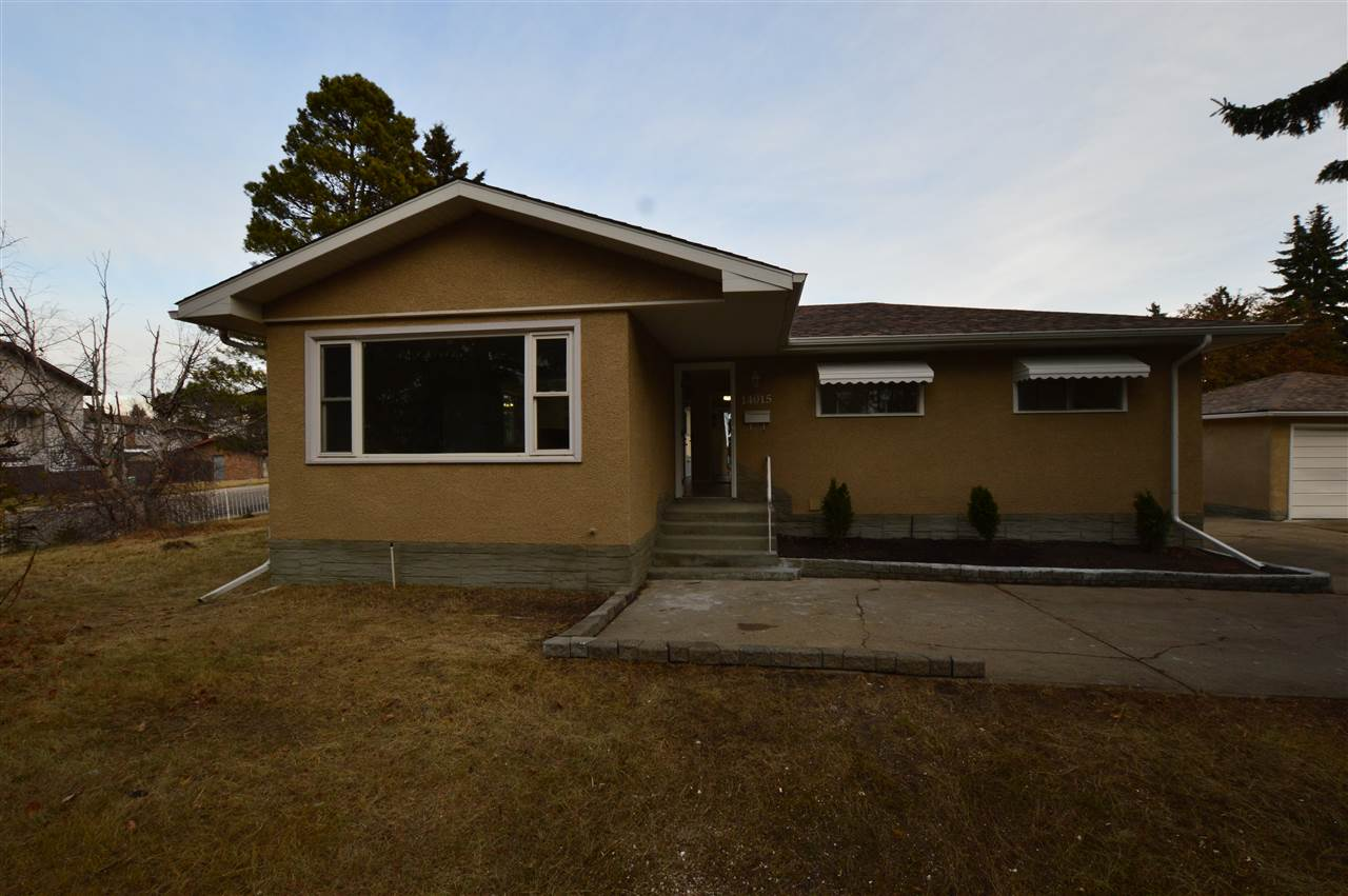 HUGE Double lot ( with 2 certificates of title). This immaculate, upgraded bungalow boasts hardwood  and laminate flooring, beautiful and large kitchen with SS Appliances, spacious living room, vaulted ceilings, Upgraded attic insulation, upgraded bathrooms (master bedroom has 2 piece ensuite) and three bedrooms on the main floor. Just renovated with new laminate flooring, newer furnace/HWT,new light fixtures, new doors / closet doors, painting (interior /exterior), new shingles on a house /garage and more. The basement (with separate entrance) is finished and features 2 additional bedrooms,  upgraded bathroom,  second kitchen, large living room with a feature slate- surround, wood burning fireplace, and a office or 6th bedroom area. Stepping outside you have a huge yard, double garage plus enough concrete parking area for up to 7 more vehicles.  With the RF4 zoning you can build 2 houses, or 2 duplexes  making this an incredible investment. Entrance to the property from 82 st and back alley.