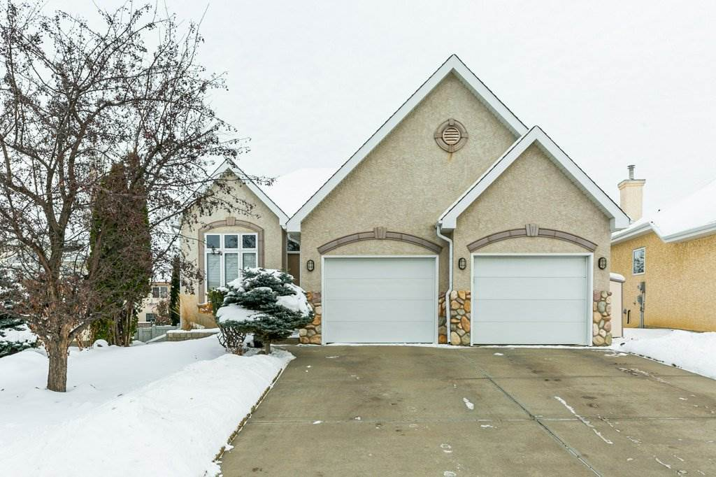 This impressive WALK-OUT BUNGALOW built by Burke Perry with numerous upgrades is situated in a QUIET cul-de-sac. 10' ft ceilings (main)  & 9' (fully finished basement) lend an air of openness. Zoned in-floor heat combined with forced air provide a comfortable & healthy living environment. Brick feature wall & gas fireplace in great room, transom windows provide lots of natural light. Main floor flex room & large dining room perfect for entertaining. Spacious kitchen with maple cabinets, bar-style island w/baking counter, walk-in pantry & high end SS appliances. The full width deck off the kitchen has gas BBQ hook-up & is finished in obscured glass. Two bedrooms on main floor, the master en-suite has an ultra-bath spa & glass shower. Open curved maple staircase leads to the lower level with big recreation & family rooms, wet bar & private patio, two bedrooms, 4 pce bath, hobby room & laundry room. Ideal location close to stores, Terwillegar Rec Centre, schools, bus service & walking trails. IT'S A WINNER!