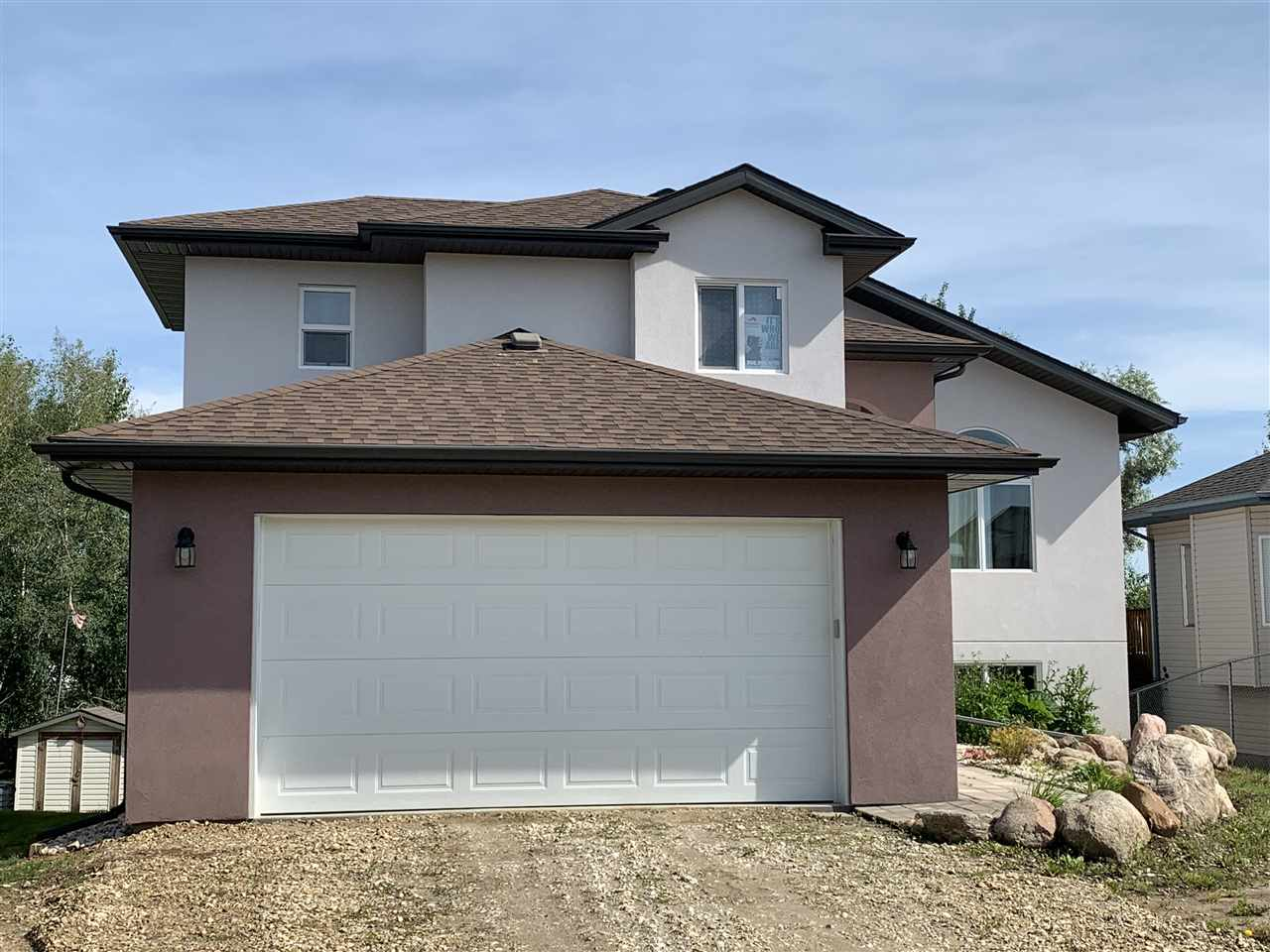Custom Built Walk-Out backing on to a green space .This well appointed 4 Bedroom 3Bath Finished up and down Home is Brand New. Features 10 year warranty has a Large Master Suite over the garage .Open floor plan great family home 3 Large decks offering plenty of out door space Kitchen dining Living area wide open concept .Double heated garage basement fully developed large bedroom and 3 piece bath wet bar ,with patio doors for the walk-out This home has the Acrylic Stucco adding extra r value making this home very energy efficient .