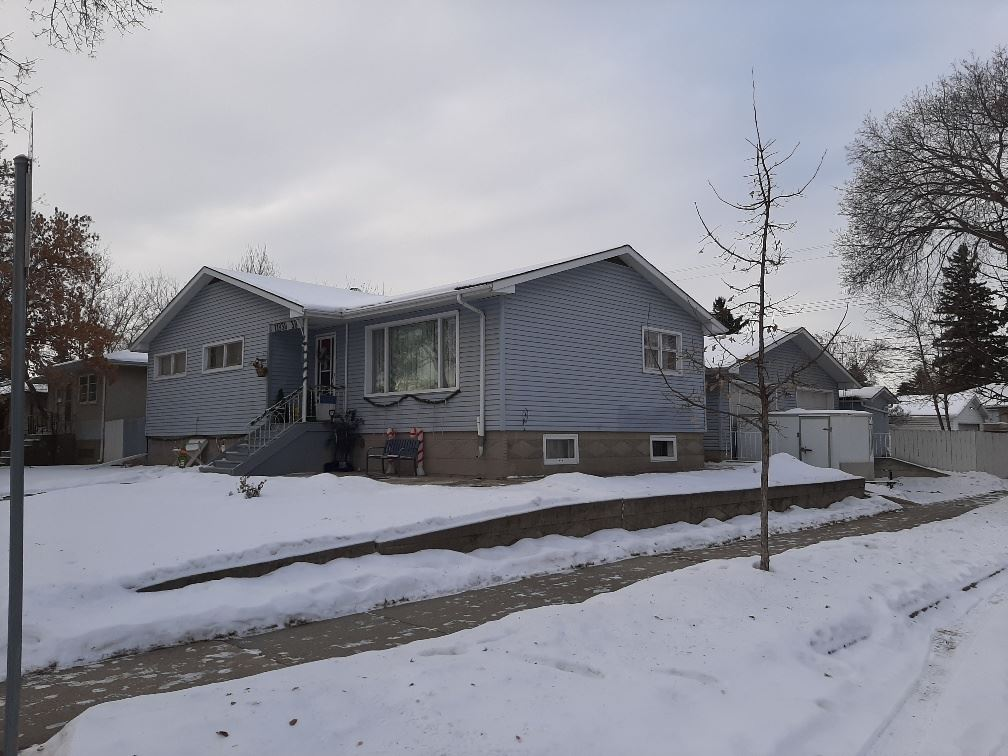 Great family home in Beacon Heights! total 4 bdrm/ 2full baths w/ well over 2300 sqft of living space on a huge 7933 sqft. corner lot. With a mechanic dream oversized 32'x27' heated garage w/10ft overhead doors, RV parking, huge back yard w/ a shed. garden & room for the kids + pets to play. The main floor offers a oversized living room, separate dinning room w/built in wall unit. 3 Lg main floor bdrm +  a full 4 piece bathroom. The huge basement has an oversized family room (can add a 5th  bdrm). w/a wet bar. There is a 4th bdrm+ 3 piece bathroom and a kitchenette w/a full size stove and fridge. There is a lg laundry/ furnace room with plenty of storage area. This is a great family home with walking distance to school, shopping and bus stop! All appliances and house Sold As Is Where Is.