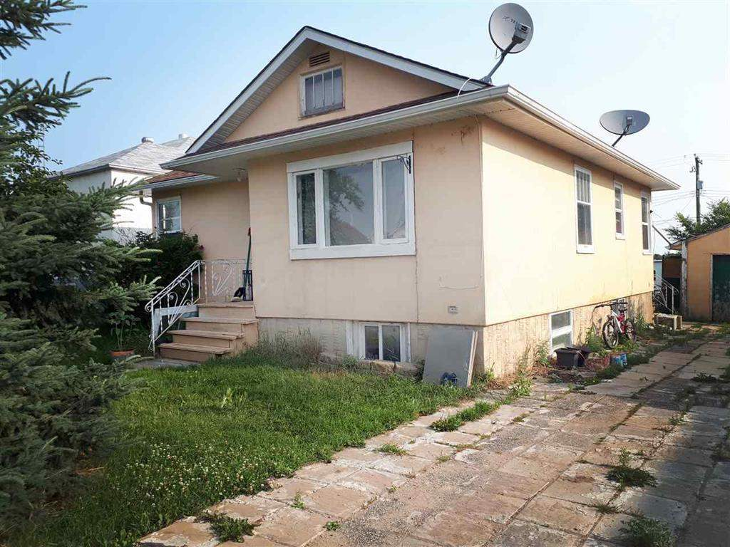 Ready to be brought back into it's former glory, this 1053 sq ft bungalow big kitchen, 4 bedrooms, and 2 full bath. Fully finished basement. Huge 50 X 140 sq ft lot, backing onto the green space of the Holden Recreation Sports Complex with Arena, etc. Double detached garage