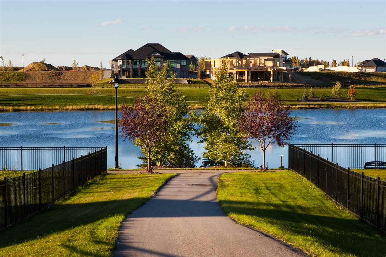 Welcome to the most prestigious neighborhood in Stony Plain, just 20 mins west of Edmonton! Architecturally controlled, executive homes with many walking trails, parks, and gorgeous views of the lake. Amenities at your fingertips with the famous Sorrentino's restaurant, gas station and boutique shops. Elementary, junior and high schools are all just a short walk away. This expansive, executive lot holds a 90 building pocket with frontage of 104 ft and is just under 0.5 acres. Extra privacy backing vast open westerly skies with no one behind and a walking trail on one side and views of the lake make this dream lot the perfect place to call home. GST is included in price. Don't miss out on this stellar lot with great value! Choose from one of the preferred builders or select your own. Vendor take back options available.