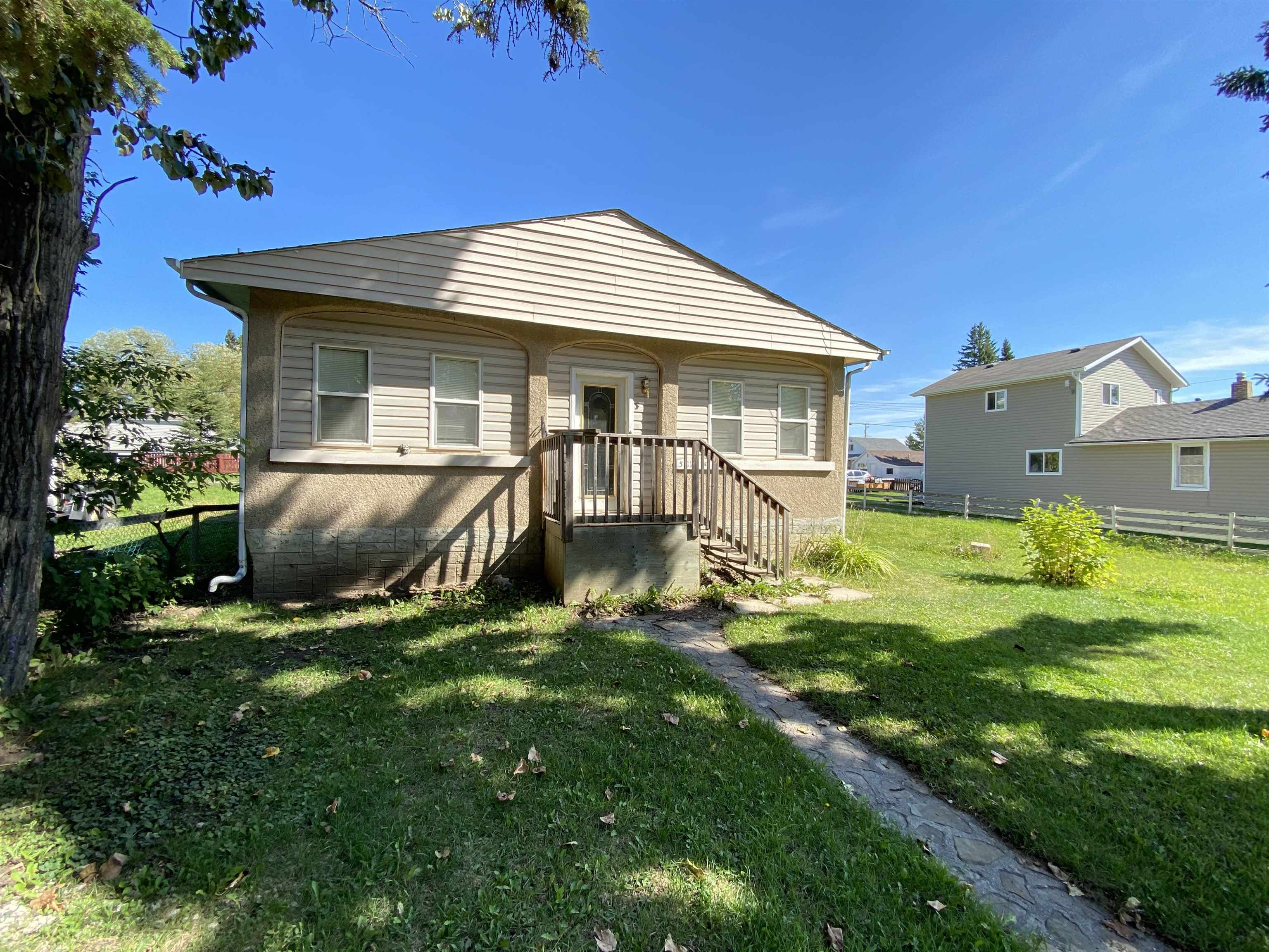 Great starter home in the town of Breton. This 3 bedroom, 1 1/2 bath home has had some great updates done over the years. As you enter the home you will appreciate the spacious living room and kitchen area. With a separate dining area as well, this home has room for the whole family! 2 bedrooms on the main floor including the large Primary bedroom, along with an updated 4 pce bath that features a claw foot tub to relax in after a long day. The main floor has had vinyl plank flooring installed throughout too! The basement area features a 3rd bedroom, family room, and a 2 pce bath. Outside the large lot is fenced with back alley access.