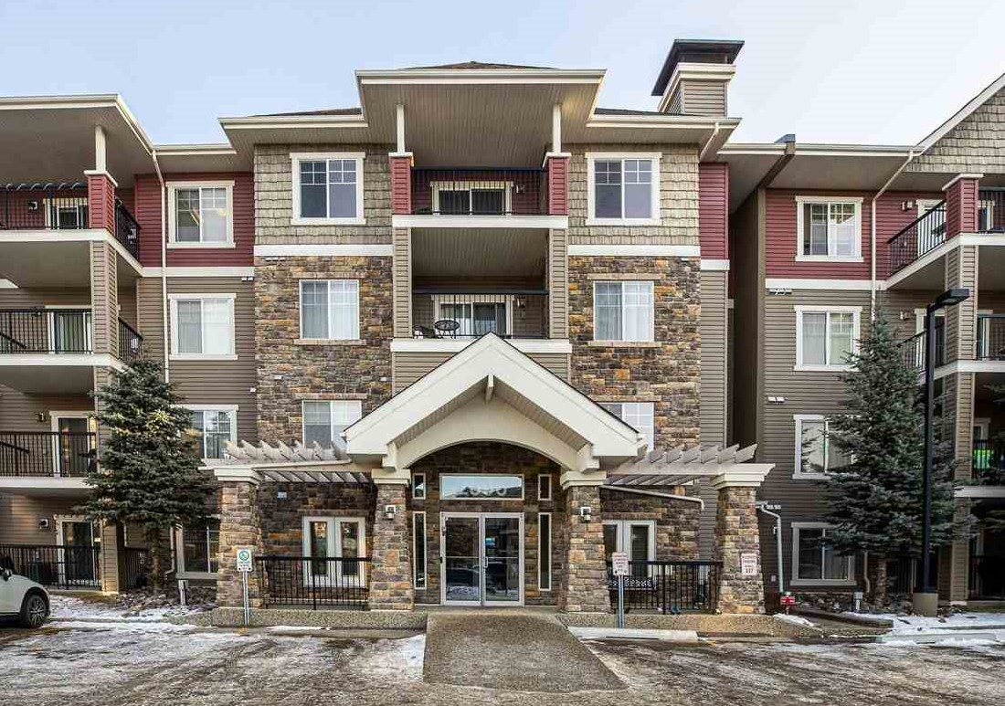 This quiet TOP FLOOR, AIR CONDITIONED condo with 2 TITLED PARKING STALLS (1 underground + 1 outside) has everything a person could ask for. This spacious 1050 sq.ft. unit has 2 bedrooms & 2 full bathrooms. There is brand new vinyl plank flooring in the Kitchen, dining area & living room with a corner gas fireplace. There is loads of storage with the large in-suite storage/laundry room.  This unit has a sunny east view & a balcony with a natural gas BBQ hookup that overlooks a quiet residential setting. The Tradition of Southbrook is a very well managed building with excellent amenities that include multiple fitness rooms, a social room, a rec room & a theatre. Conveniently located just steps from loads of shopping, schools & public transportation. It is also just minutes from the Anthony Henday & Calgary trail.
