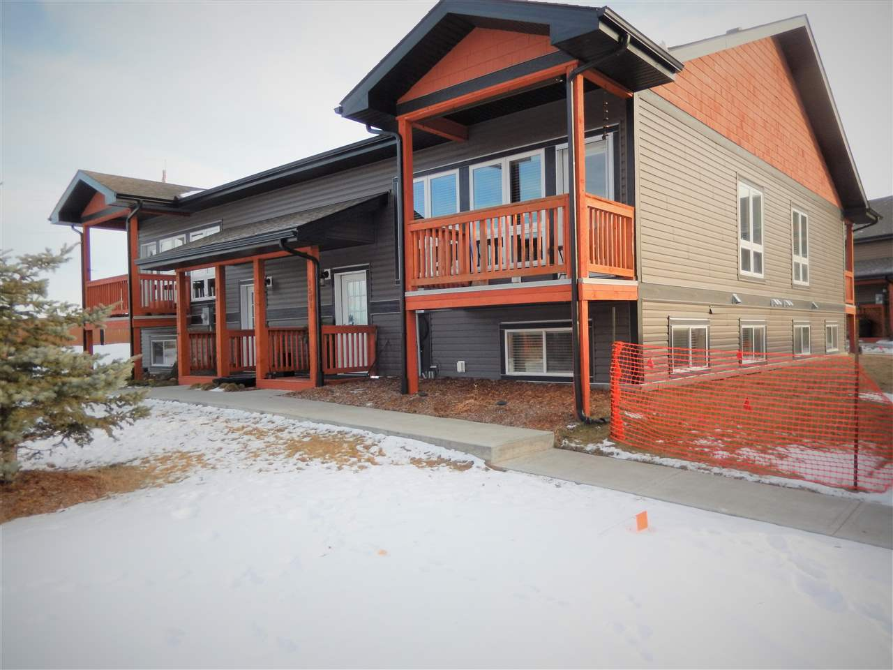 This 2015 Unit has one of the few DOUBLE CARPORTS that allows you to see your vehicles from your Unit! It also sits on the outer area of the complex & has a BIG GREENSPACE between the Units backing onto a HIGH FENCE. This BI-LEVEL with 9' CEILINGS has the OPEN CONCEPT kitchen, living rm, dining rm, 2 pce bathr & pantry on the Upper Level. On the Lower Level sits the full bathr, 2 bedrs, laundry area & storage/utility rm. You will love the kitchen with LARGE ISLAND/EATING BAR, GRANITE COUNTER TOPS, STAINLESS APPL & GLASS BACKSPLASH. The BIG WINDOWS are plenty & there is a GARDEN DOOR out to the UPPER NW facing BALCONY. The master bedrm has a WALK-IN CLOSET & both bedrs have an attractive ledge along the walls under the windows. The DOUBLE CARPORT has LIGHTS (remote) & 2 PLUG-INS and a LARGE SECURED STORAGE SPACE. Construction of these units included the latest technology...ICF BLOCK foundation & RIGID STYROFOAM under the basement for extra warmth. ONE PET ALLOWED!