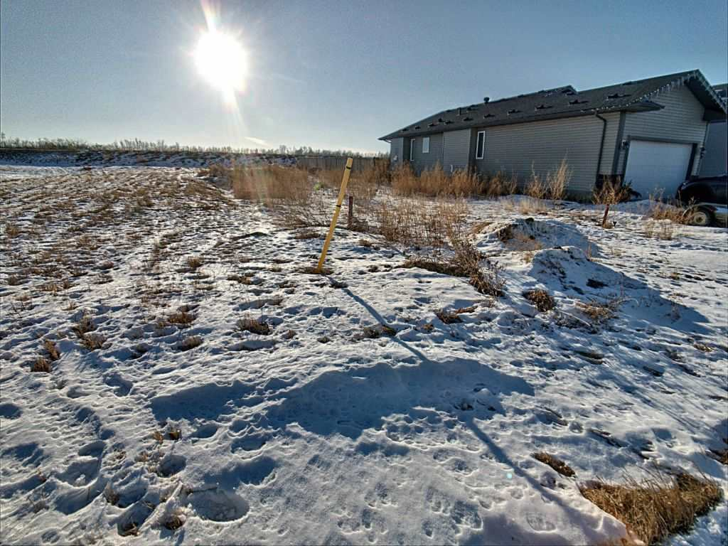 Lot 52. Fully serviced lot available to build your dream home in a new neighborhood (West Woodlands) in family friendly Bruderheim, just 35 minutes from Edmonton and less than 15 minutes from the oil & gas plants in Fort Saskatchewan! This lot has a 34 ft building pocket with 44 ft frontage and 110 ft lot depth (4854 sq ft) with a south facing backyard with no back neighbour but there is a neighbour on one side that already has the fence up so only 2 sides to fence. Great location close to the town sports fields, campground, and brand new skate park. Tremendous small community for young families with a great K-9 school and several employment opportunities in the area. Architectural guidelines, geotechnical reports, land use district, subdivision plan, and engineering package is available and included with the lot.