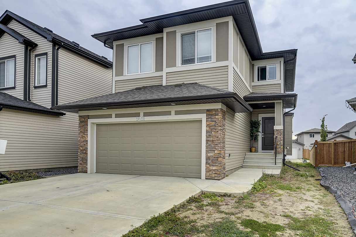 FULLY FINISHED 2 STOREY HOME W/LOTS OF UPGRADES, 3 BDRMS & 2.5 BATHS PLUS A LEGAL 1 BDRM SUITE W/KITCHEN IN THE SOUGHT AFTER COMMUNITY OF SECORD! This Bright & Upgraded Main Floor Features a Grande Foyer, Beautiful Eat-In Kitchen w/S/S Appliances, Granite Counters, Island w/Eating Bar & Pantry. Perfect for Entertaining w/the Kitchen Open to the Dining Space & Great Rm w/Gas F/P w/Mantel and a 2 Pce Powder Rm complete this level. Upstairs Boasts a Big Bonus Room, Convenient second fl laundry, Master Suite has a Large Walk-In Closet & 6 Pce Ensuite w/His/Her Sinks & Jacuzzi Tub! 2 more generous sized Bedroom finish this floor. The BSMT has a Legal Suite that previous tenant was paying $1200/mth, Amazing mortgage helper! Close to ALL Amenities Incl. New K-9 School, Public Transit, Parks & Future Rec Ctr. Easy Access to the Whitemud, Anthony Henday, Hwy 16A & the Yellowhead! SHOW WITH CONFIDENCE.