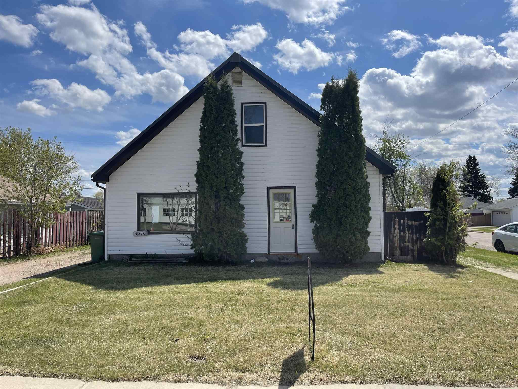 """This 1253 sq. ft 1 and a half storey is in a great location in relation to schools and main street. Most everything has been updated. Kitchen/Dining area is open and modern. Living area is roomy. Main floor has 1 bedroom,  a 4 pc. bathroom and the back entry has laundry and storage rooms for easy access. Upper level has 2nd and 3rd bedrooms. The yard is fenced and private. This home had a new high efficient furnace installed and a new metal roof. Property is sold """"As is"""" """"where Is""""."""