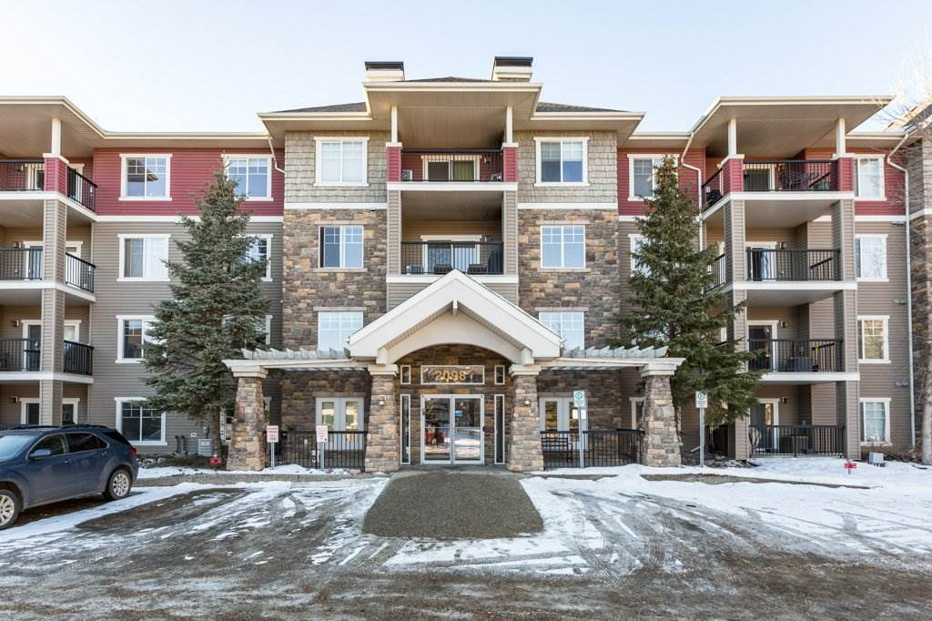 This beautiful condo is situated in the sought after 'The Tradition at Southbrook' complex. Personalize this unit with a $4000 CREDIT offered by the seller! You will enjoy a light open floor plan, 2 good sized bedrooms, open kitchen with black appliances and island, dining room, & large living room with corner fireplace. West facing balcony offers beautiful natural light. The master bedroom enjoys a walk through closet & a 3-piece ensuite, the second bedroom has an adjacent 4-piece bathroom. The building offers outstanding amenities including: a Guest suite, gym, games room featuring pool tables, social rooms & secure underground parking. Close to public transportation, shopping, banking facilities, coffee shops, restaurants, walking distance to grocery stores & trail system. This unit can be yours!