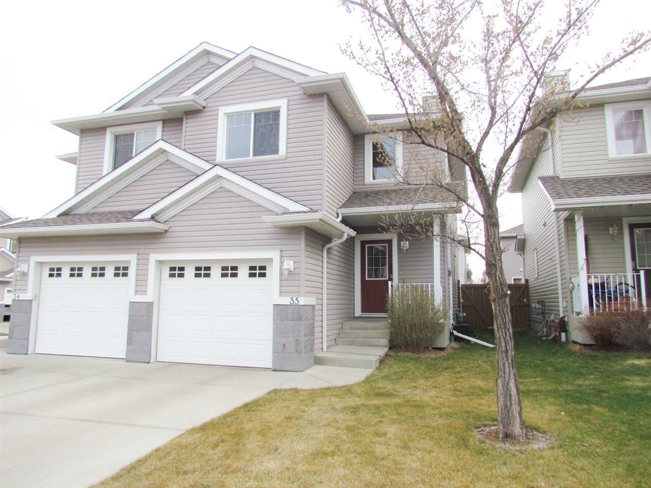 Absolutely spotless! You will love this spotless fully finished 2 bed 2.5 bath open great room concept in in Hodgson close to everything! The main floor features open concept perfect for entertaining with large kitchen & plenty of cupboard space including large island with granite! Wall to wall engineered hardwood throughout. The upper level has 2 huge bedrooms both with walk in closets and 2 4 piece bathrooms upstairs. The fully finished basement has a flex room that can be a family room, office, or gym. A patio door leads to your very own private 6 ft high fenced backyard. All conveniently located within walking distance to the Market of Magrath, Terwillegar Rec Center, park, running trails, Anthony Henday & public transportation!