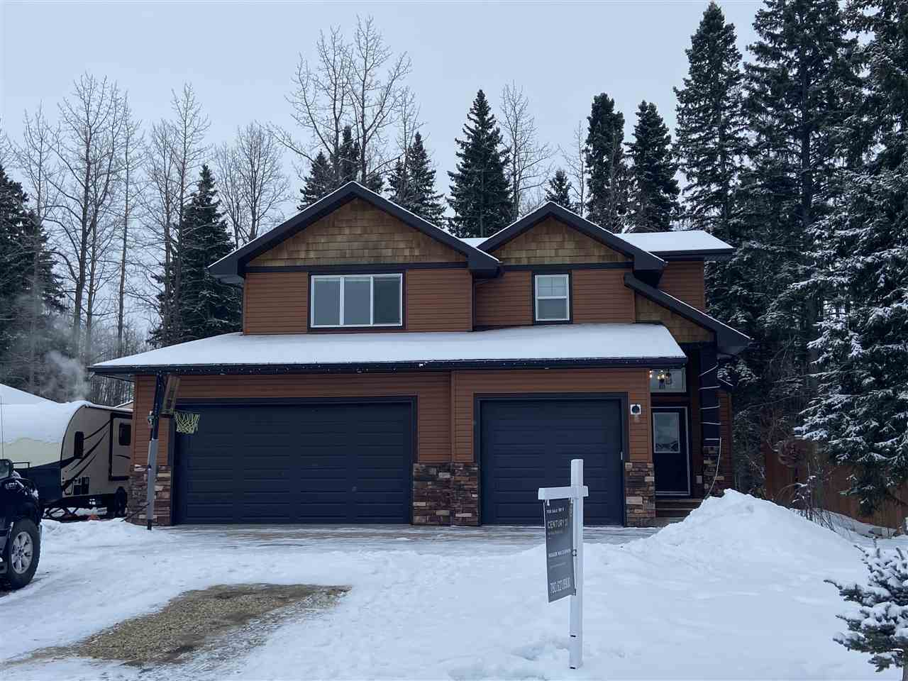 This beautiful custom built home rests on a 0.26 acre parcel and is located at Deer Crossing Estates in Breton! This wonderful home backs onto the green at Hole # 7 of the Breton Golf Course! With trees behind you this home feels like acreage living w/ the quick access to amenities a community offers. Entering the home you'll be thrilled w/ the soaring ceilings and stone enclosed fireplace in the living room. The kitchen is truly special w/ lots of granite, counter space, and a massive island complete with bar seating! The ensuite in the MBR is very elegant and features his & her sinks. The wooded deck overlooks your privately treed backyard complete w/ fire pit area and dog run! Downstairs one finds the 4th bedroom, large rec room and walk out basement. If one wants to add a suite below, the plumbing & electrical exists downstairs for a 2nd kitchen to be added (basement is plumbed for in floor heat). Don't forget the triple garage and RV hookup! Breton is easily commutable to Leduc or Drayton Valley.