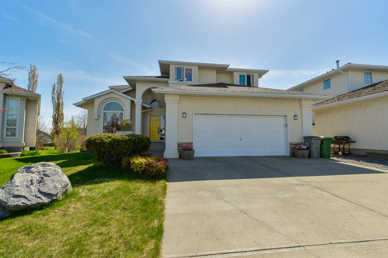 PRICED TO SELL!! Original Owner 2 Storey w/ APPROVED COMMERCIAL KITCHEN in bsmt located on large pie shaped lot backing 11th green at Coloniale Golf Course! 4 bedrooms w/ 3 up & 1 down. 4 full bathrooms! 5pc upper, 4pc master ensuite, 3pc on main & 3pc in bsmt. Front entry showcases staircase to upper level w/ flex room featuring large west facing window. Family room w/ open to below ceiling, hardwood & gas fireplace. Updated kitchen w/ GRANITE countertops, NEW Stainless-Steel appliances, plenty of cabinets w/ hidden pantry! Spacious dining overlooks golf course. Main level has IN-FLOOR HEAT! Master w/ walk-in closet, 4pc ensuite w/ GRANITE counter, new tap/tile/light fixture, jacuzzi, shower & bay window overlooking golf course. Updated 5pc bath equipped w/ LAUNDRY CHUTE! 2 large bedrooms w/ built-in desks (GRANITE). Finished BSMT w/ APPROVED COMMERCIAL KITCHEN, 4th bedroom, large rec room w/ electric fireplace. POOL TABLE & BAR INCLUDED. Beautifully landscaped w/ large deck & fire pit. 23x23 garage.
