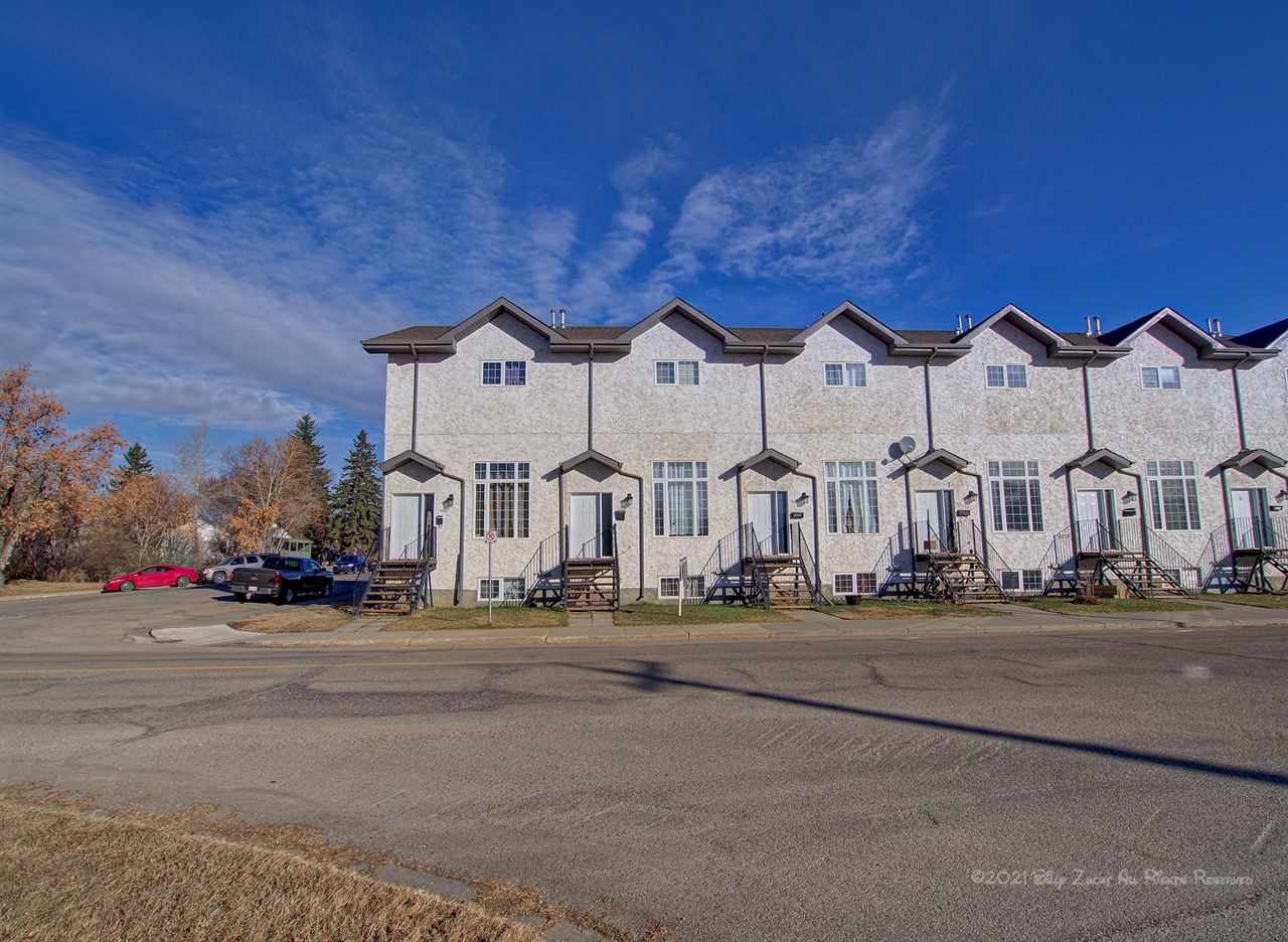 Located in the downtown area of Fort Saskatchewan is this fully developed three bedroom two storey townhouse condo with an oversized heated single car attached garage. Step thru the front door into your cozy living room with newer laminate flooring and a corner gas fireplace. Up a few steps to your country style kitchen with ample cupboard space and loads of room for a huge dining room table, plus a two-piece bathroom and patio door access to your deck off the kitchen finish this level. Upstairs you have a four-piece bathroom, three bedrooms with the master boasting a walk-in closet and a three-piece ensuite. Utilize the development in the basement as a recreation room or another bedroom. The stacking laundry area is just off the entrance to the garage. This condo is within walking distance to schools, shopping, recreational facilities, biking and walking trails.