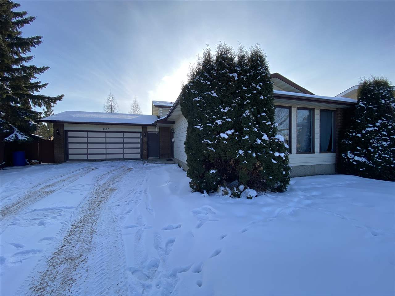 Well maintained 4 level split home in a convenient Ermineskin location! Fully developed on all levels with 3 + 1 bedrooms and 2.5 baths. Plenty of space for a growing family. Upgrades include newer shingles, furnace, hot-water tank, central air conditioning. Features an oversized Dbl attached heated garage with access from the 3rd level. Large living room and a dining room. Open style kitchen comes with ample cabinetry and breakfast nook. The upper level has 3 bedrooms, a full bathroom and a 2 piece en-suite. The lower level has a large family room, boasting a wood burning fireplace with brick facing. An extra bedroom and a 3 piece bathroom with a standing shower complete the third level. The basement is fully finished with a huge entertainment room, a laundry/utility room and a storage room. Fully fenced and landscaped with a  South facing backyard. Walking distance to schools, park and Century Park LRT stations. Close to Calgary Trail and South Common.