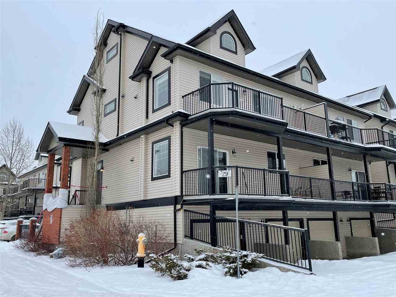 Welcome to South Terwillegar! This spacious Townhouse is ideally located close to schools, shopping & public transportation. Enjoy the open concept with cathedral ceilings & an open loft overlooking the main living area. The living room is warmed by a corner gas FP with large windows allowing for plenty of natural daylight. The kitchen has an abundance of cabinetry, a pantry & a central island island with a breakfast bar. Adjacent is a spacious dining area suitable for a large table. down the hall there are two generous bedrooms & a 4pc bath & laundry. The Master bedroom has a two pc ensuite & a large closet space. Stepping up stairs, is a huge bonus room with plenty of space for family gatherings or an additional bedroom plus a 3pc bath. Off the main floor is a huge balcony with room for patio furniture & BBQ. Downstairs, you have access to the attached garage & storage room.