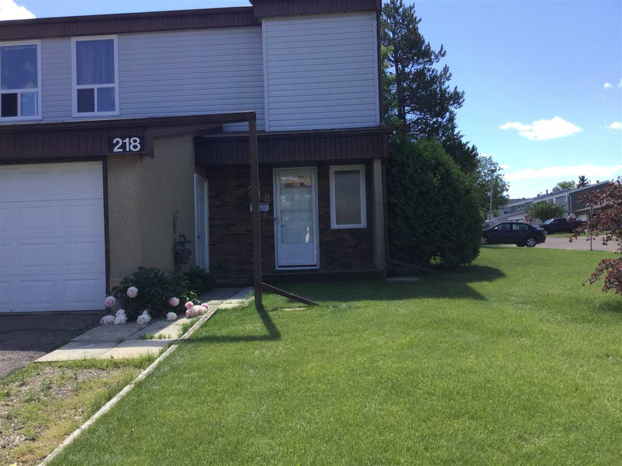 Renovated End/Corner unit featuring, attached Garage with tons of storage, 3 bedrooms, 1 and half baths and Fully Finished Basement! Including a High Efficiency Furnace, all New Vinyl Windows, Slate Flooring, New White Shaker Kitchen Cabinets with Soft Close Doors, Ceramic Backsplash, Built in Eating Bar and Pantry, Open Kitchen Concept to Living & Dining room, New Sliding Doors to Deck and New Fully Fenced Yard!! Gorgeous Fully Renovated Bathrooms, 5 Piece Main Bath comes with Double Sinks, bath/shower! Also includes Fresh Carpets, Paint , Baseboards, Lighting, upgraded Hardware & Doors!! Upstairs includes 3 good sized bedrooms and a 5 piece bath. The Master comes with huge New Windows! Tons of additional living space in the Fully Finished basement with large family room & Entertainment room. The single attached garage has an additional Loft with ample storage. Close to Parks, all levels of Schools, Shopping and Transportation.